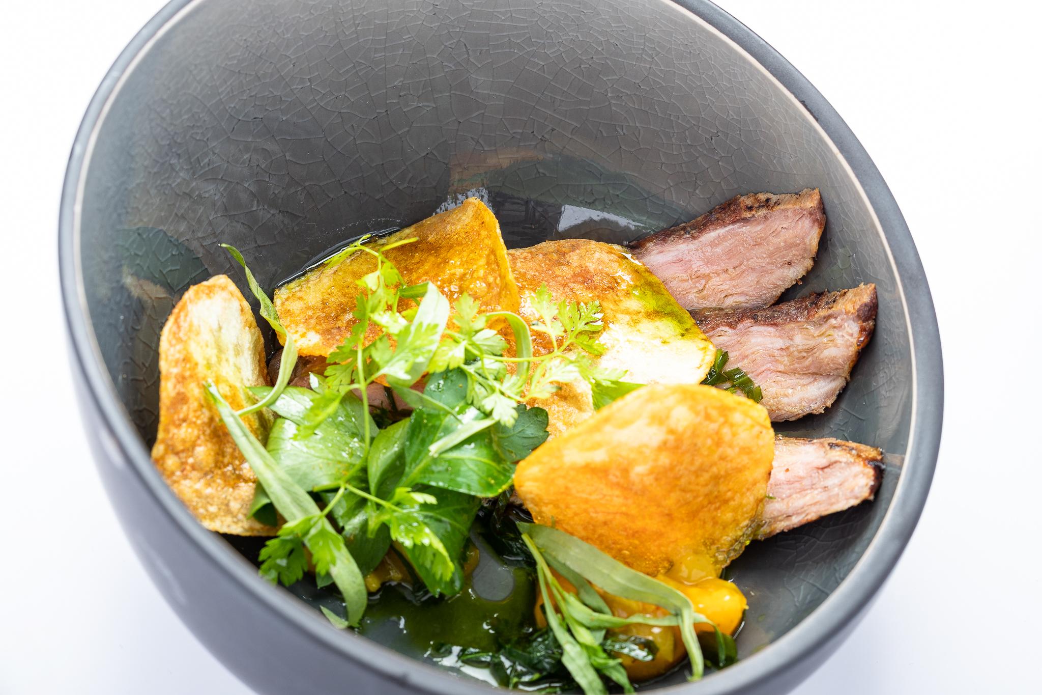 Pluma of Bras pork, salsa verde, pickles - DEN DYVER