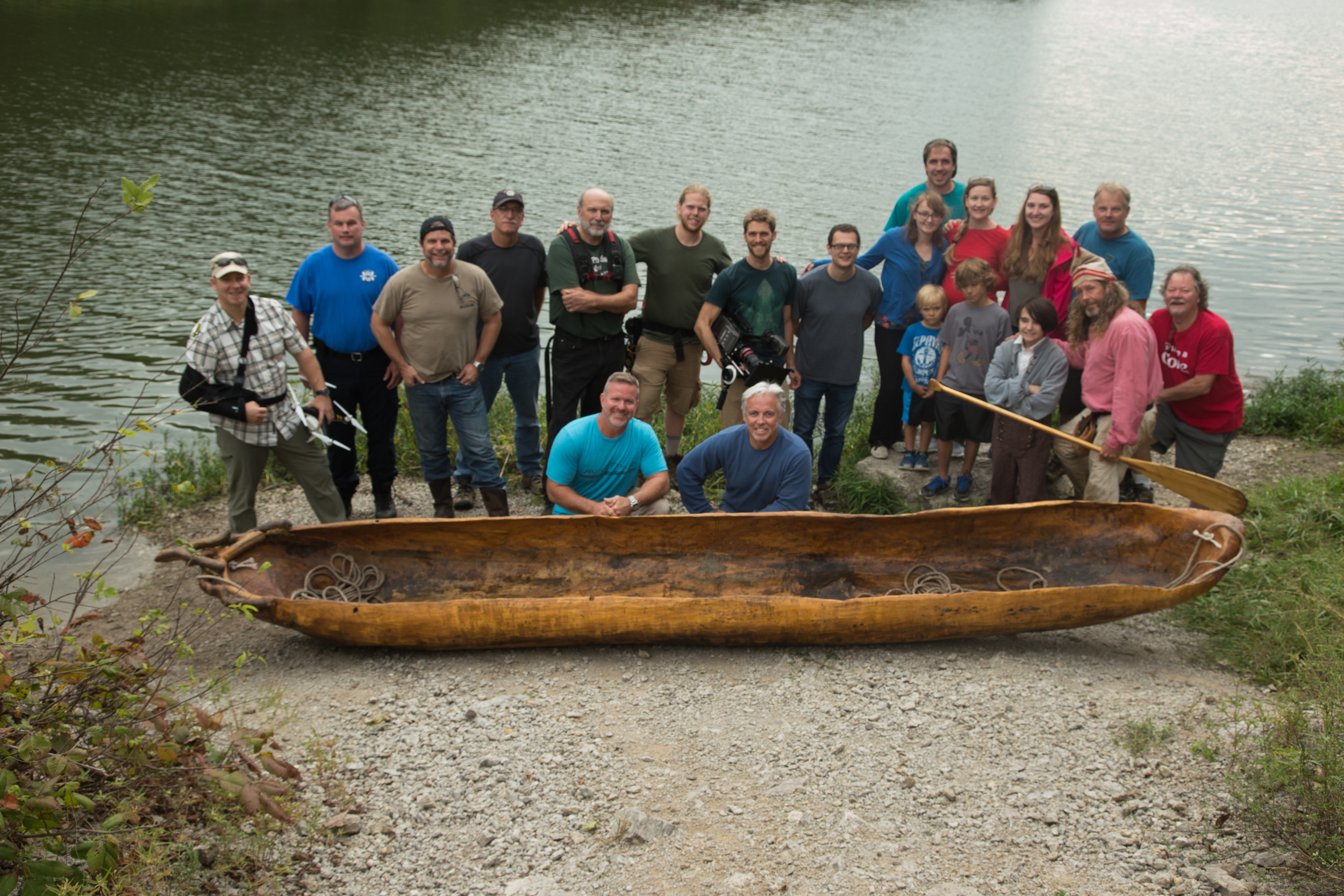 Churchhill Clark  (on right in pink shirt and liberty cap) , one of his handmade dugout canoes and the Wide Awake Films crew on location for  The American Artist: The Life & Times of George Caleb Bingham .