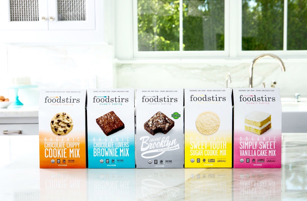 Foodstirs   At Foodstirs, our motto is to bake life sweet! Believing the heart (and stomach!) of every family can be found in the kitchen, we're founded on a mission to help create memorable, long-lasting experiences through baking. Our organic, non-GMO kits and mixes feature six or less simply delicious premium, real ingredients, free of artificial preservatives, dyes and flavors.