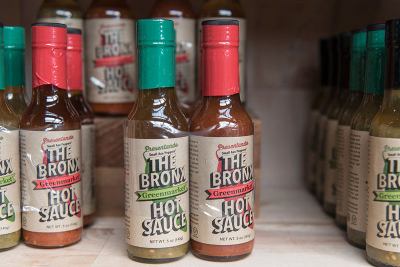 The Bronx Hot Sauce   The Bronx Hot Sauce is unique. More than 30 Bronx community gardens grow the serrano peppers which makes this delicious hot sauce. Each bottle you buy directly supports the gardens and gardeners who grow these serrano peppers.