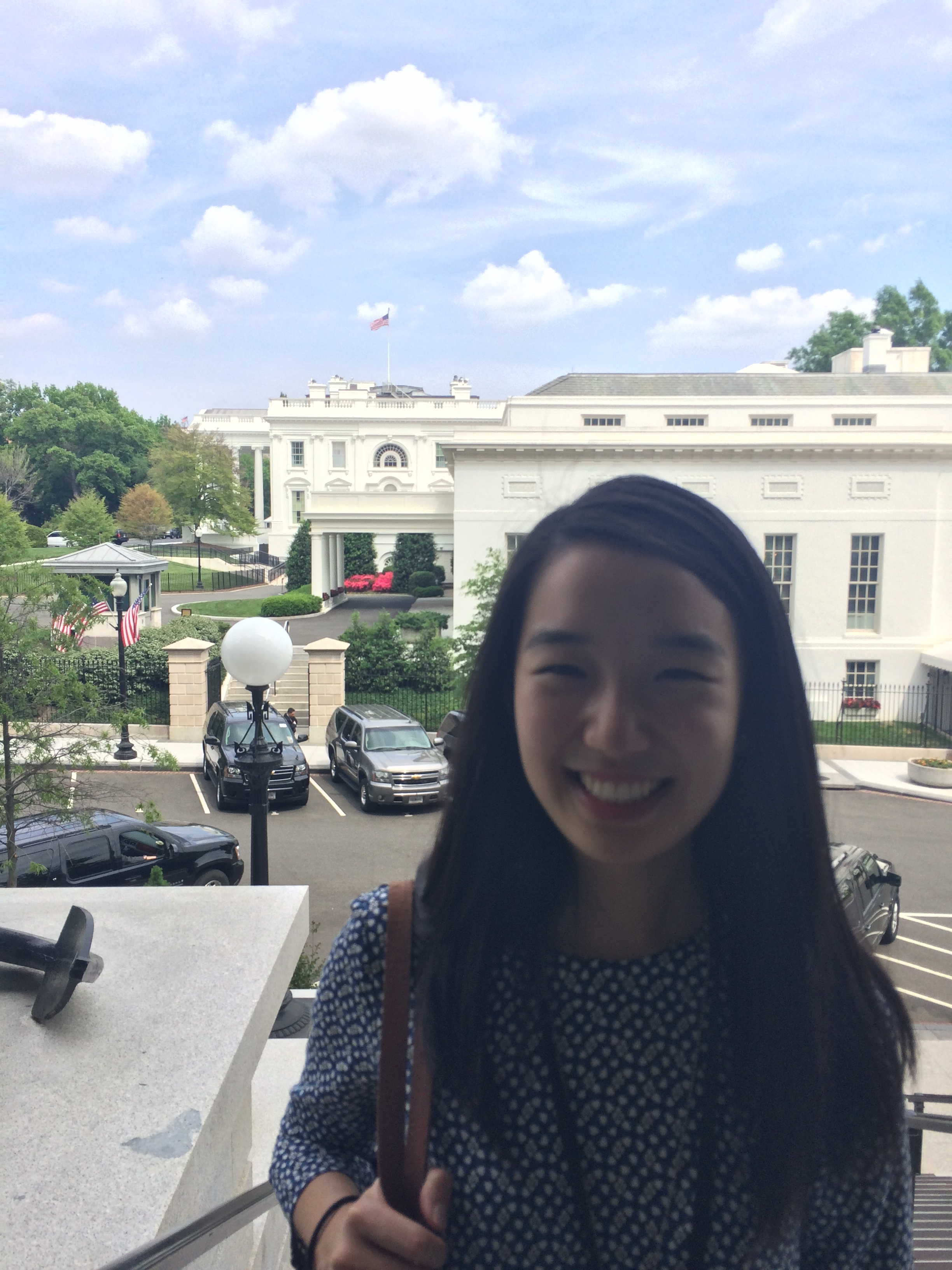 On one of my last days, I took a picture with the West Wing (behind me). You can see the White House mansion further back!
