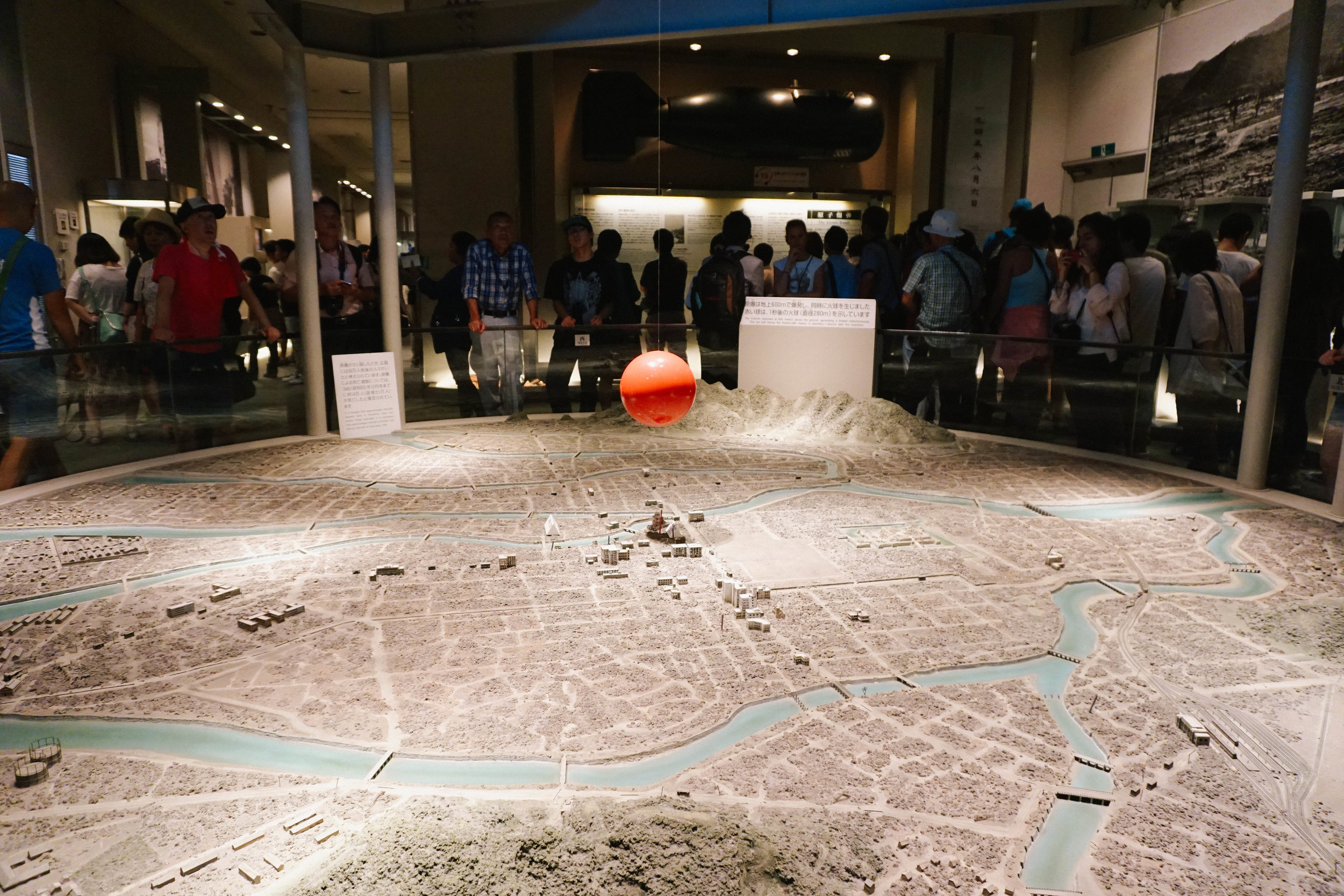 A rendering of the atomic bomb  — depicted as the red ball  — over Hiroshima.