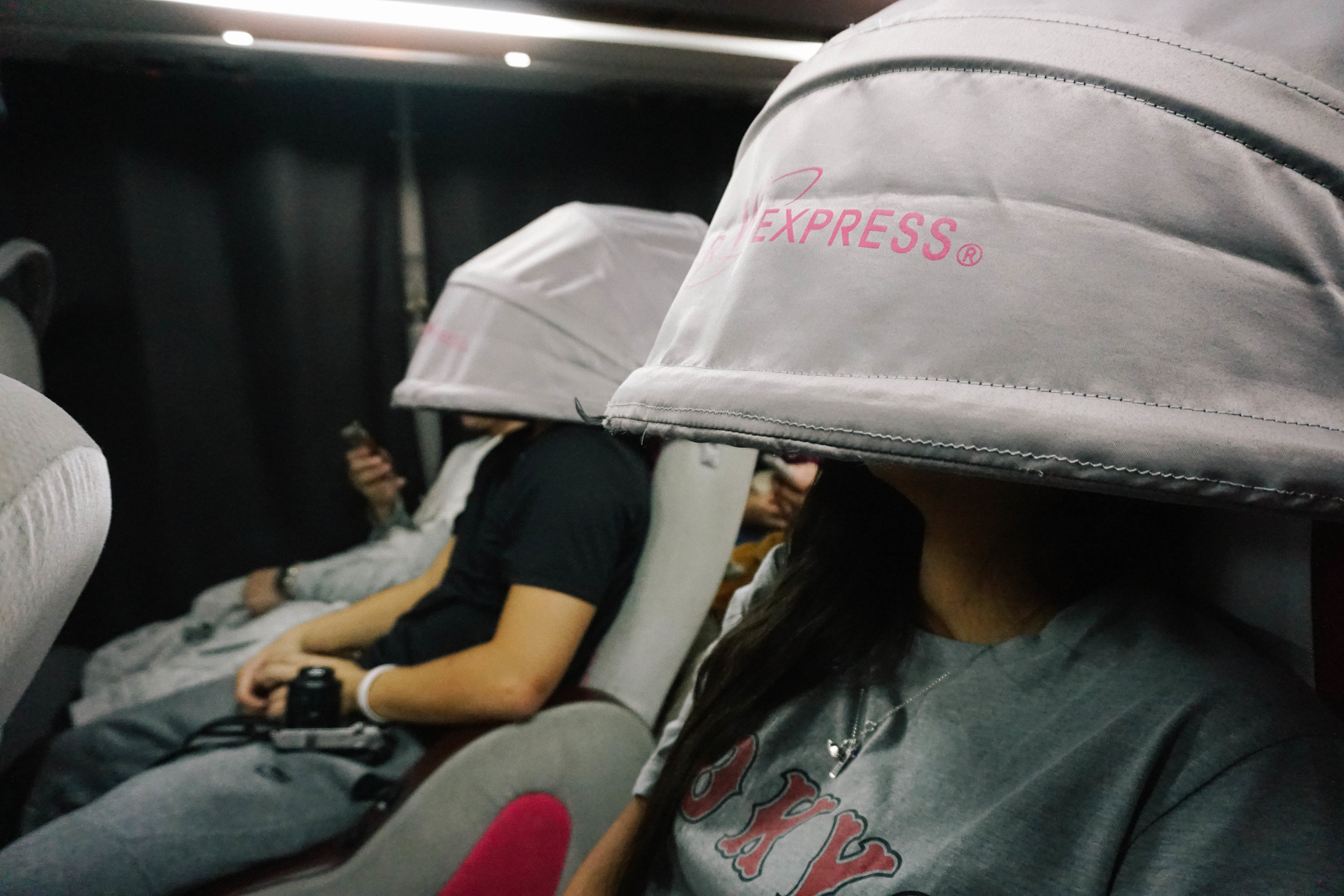 Miranda and Jun testing out the head canopies, aka the best defense against ugly sleeping photos. ;)