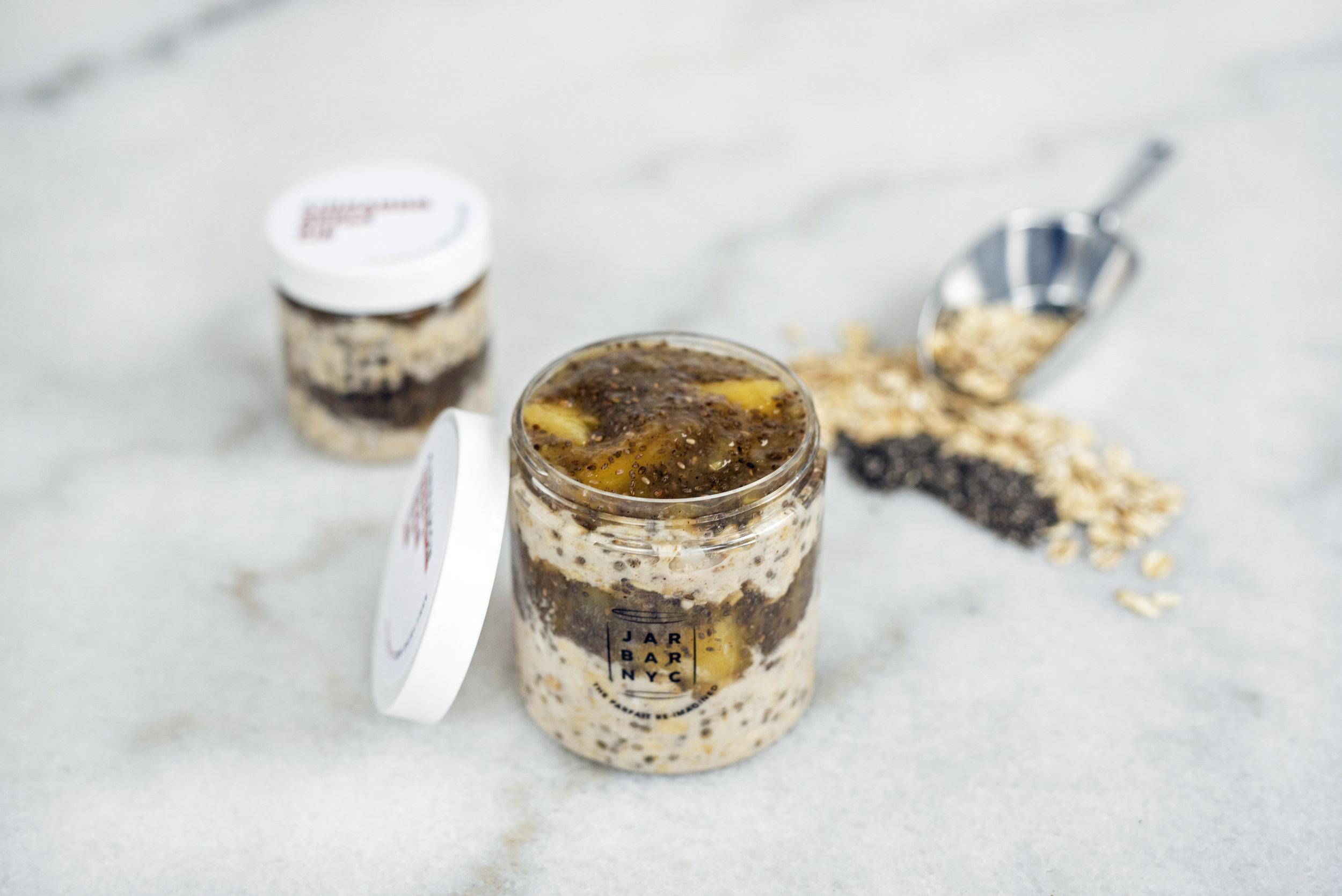 CINNAMON APPLE PIE JAR : apple jam layered with almond butter overnight oats.  Ingredients: apples, apple juice, chia seeds, oatmeal, unsweetened plain almond milk, almond butter, cinnamon, organic amber agave, fine sea salt.
