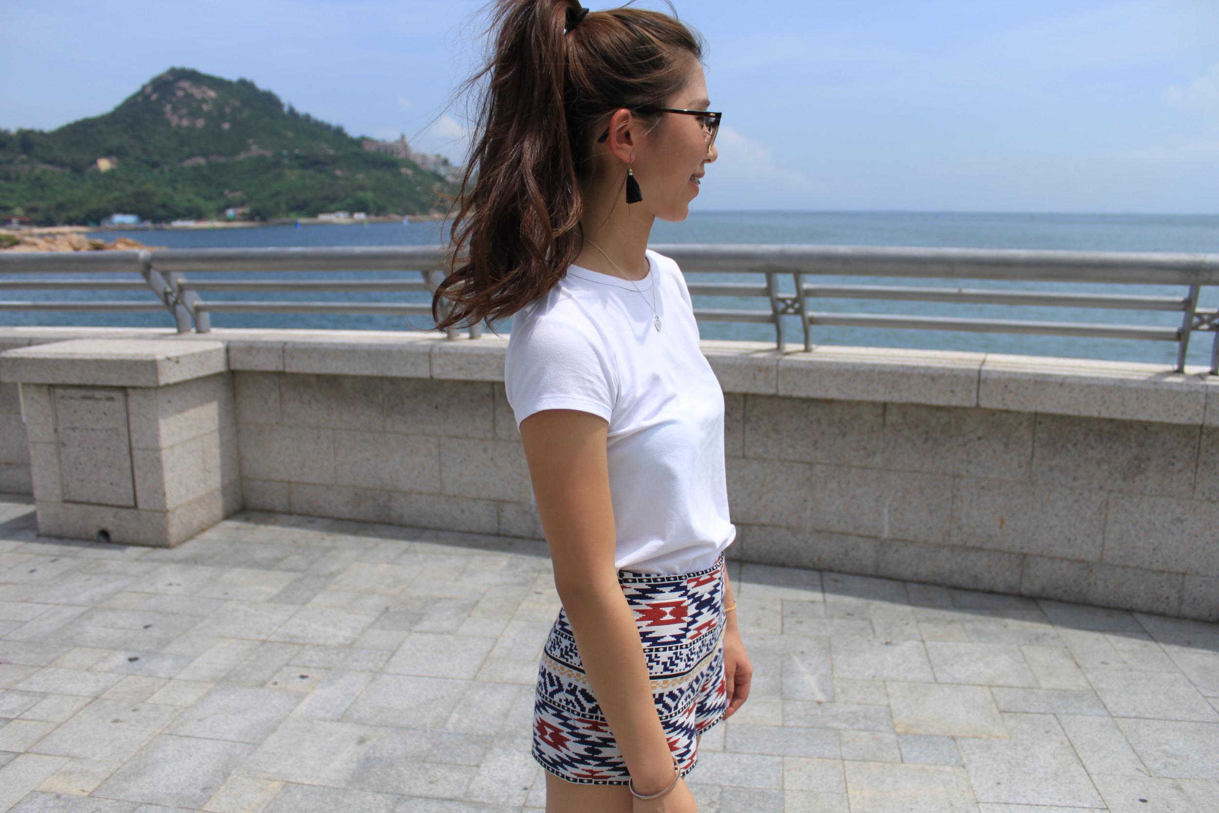 H&M white T-shirt / Zara tribal shorts / Black tassel earrings