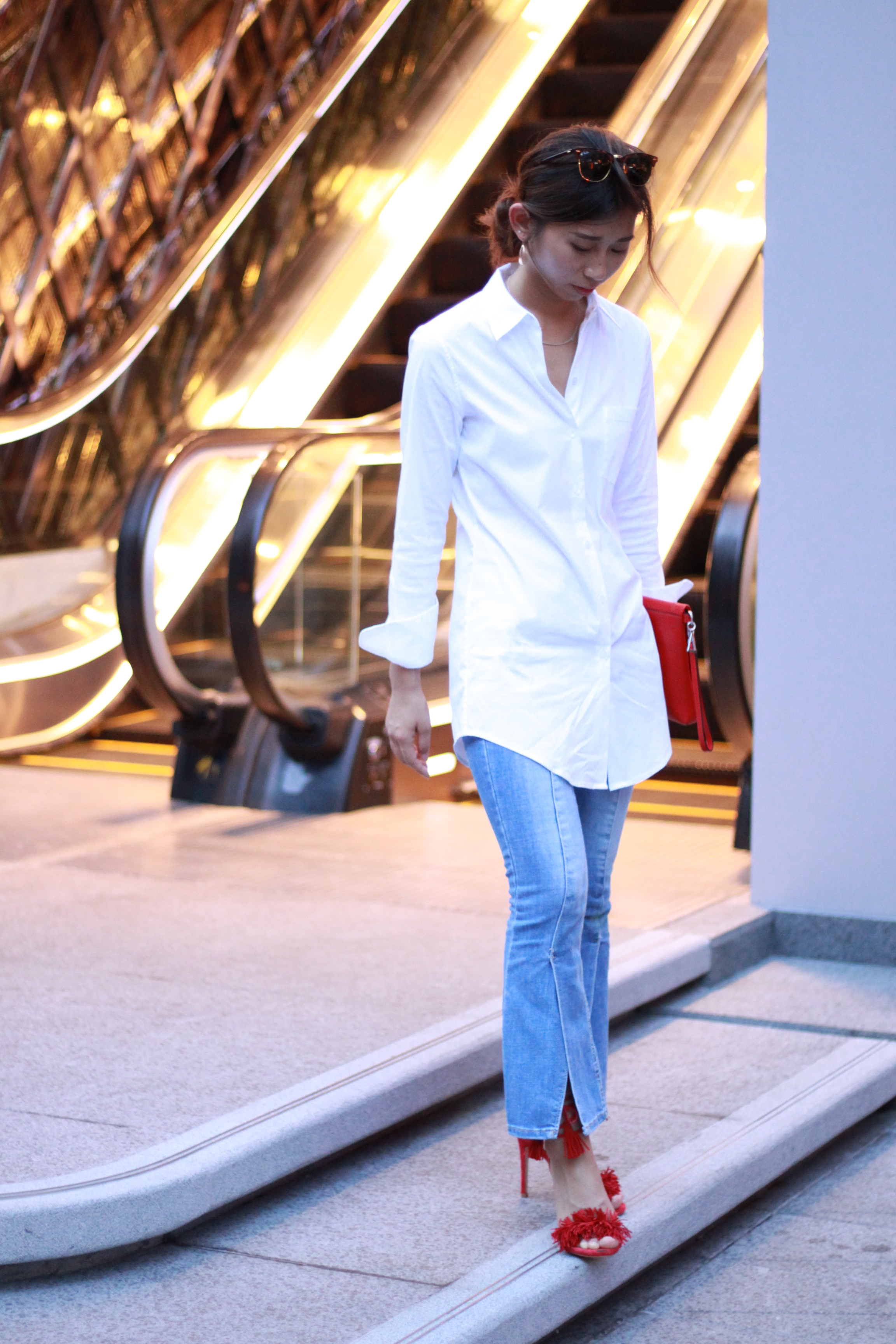 Theory  white shirt /  Amber  flared jeans / Steve Madden  red open toe pumps /  Agnes. b  red foldover clutch