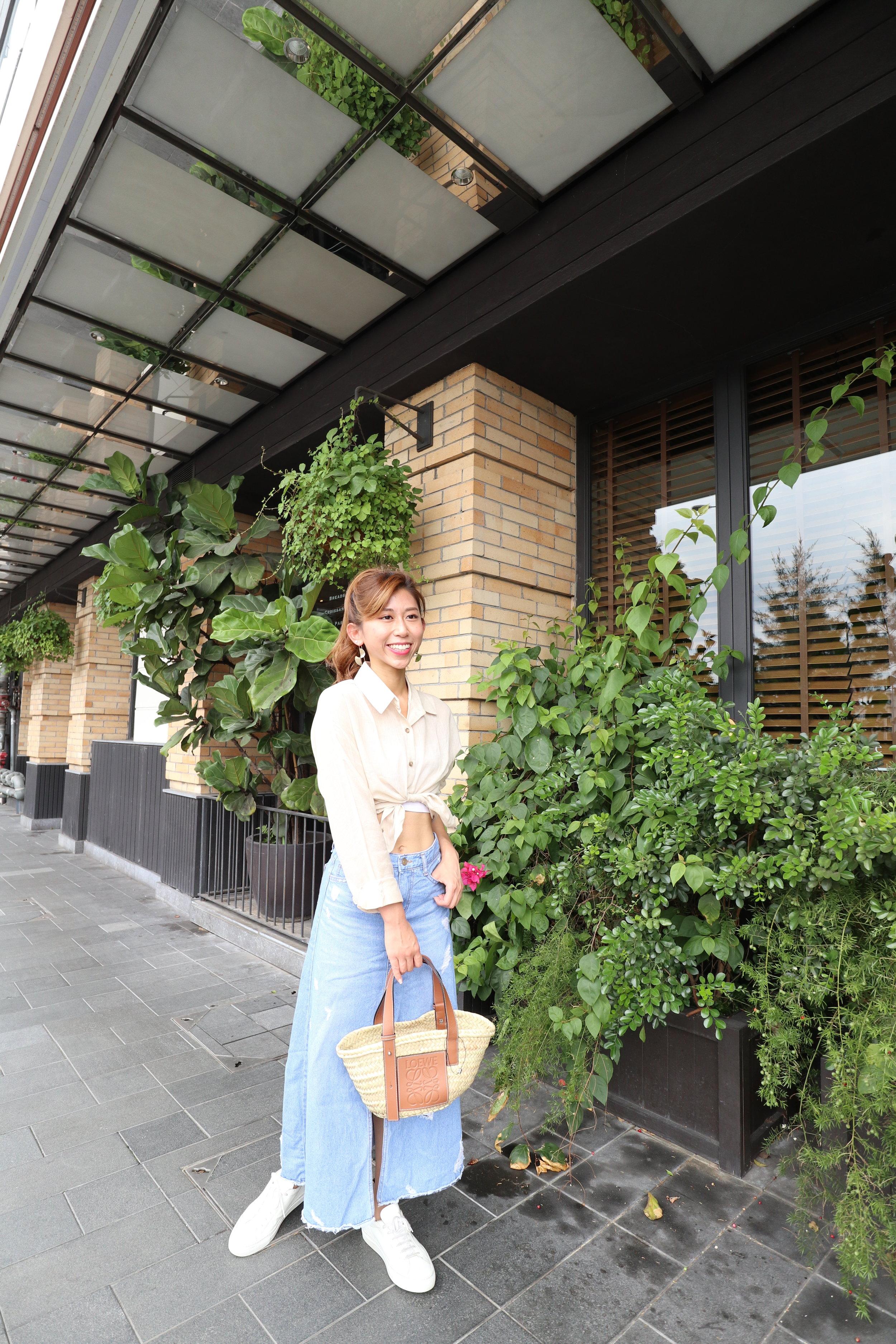 StudioDoe beige linen shirt  / StudioDoe denim skirt / Common Projects classic lace-up sneakers (glossy) / Loewe basket small bag