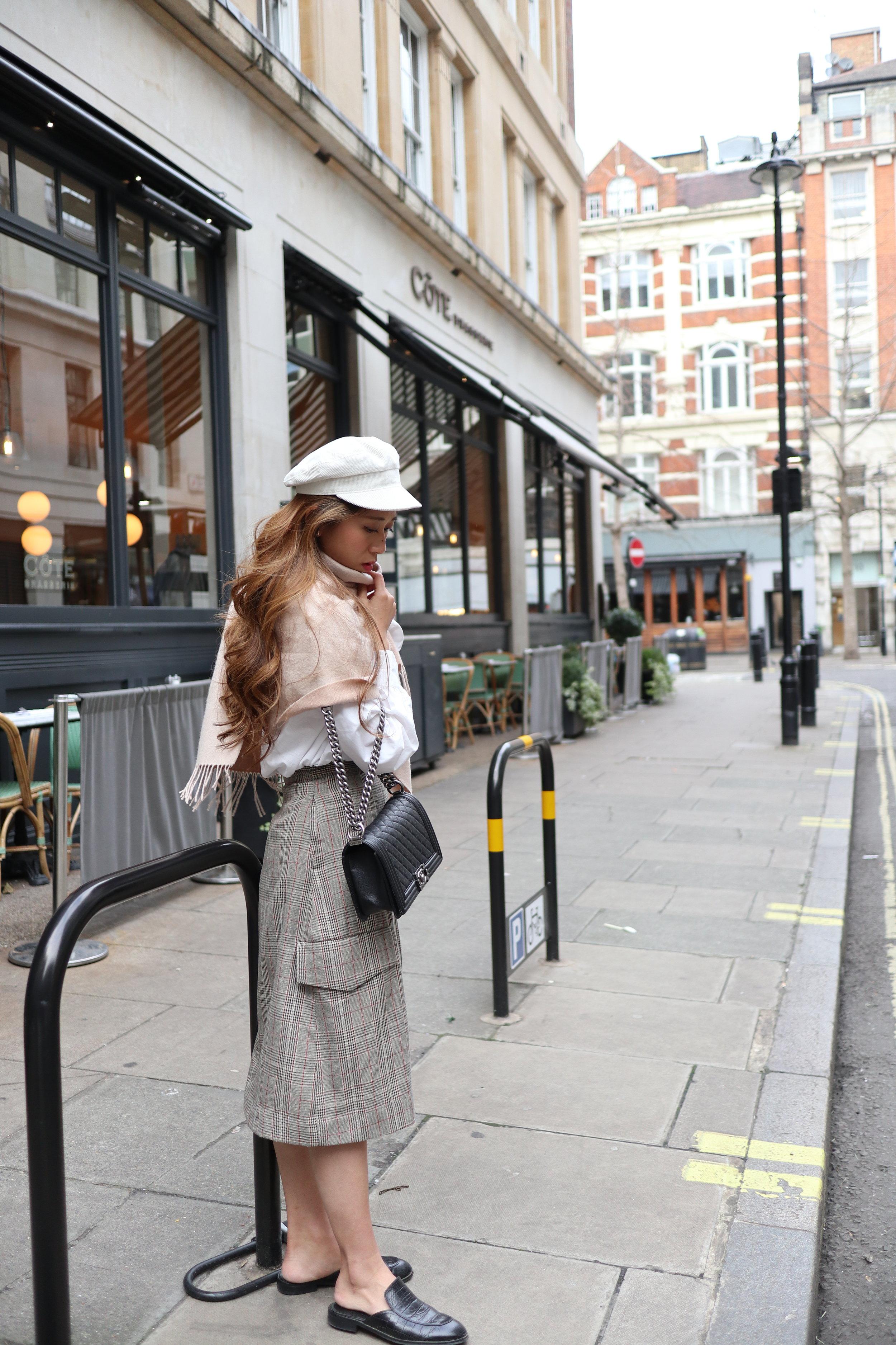White shirt from Korea /  ProjectNo8 checkered wrap skirt  / Giordano Ladies scarf / Giordano Ladies leather slides /  LACKOFCOLOR dunes cap