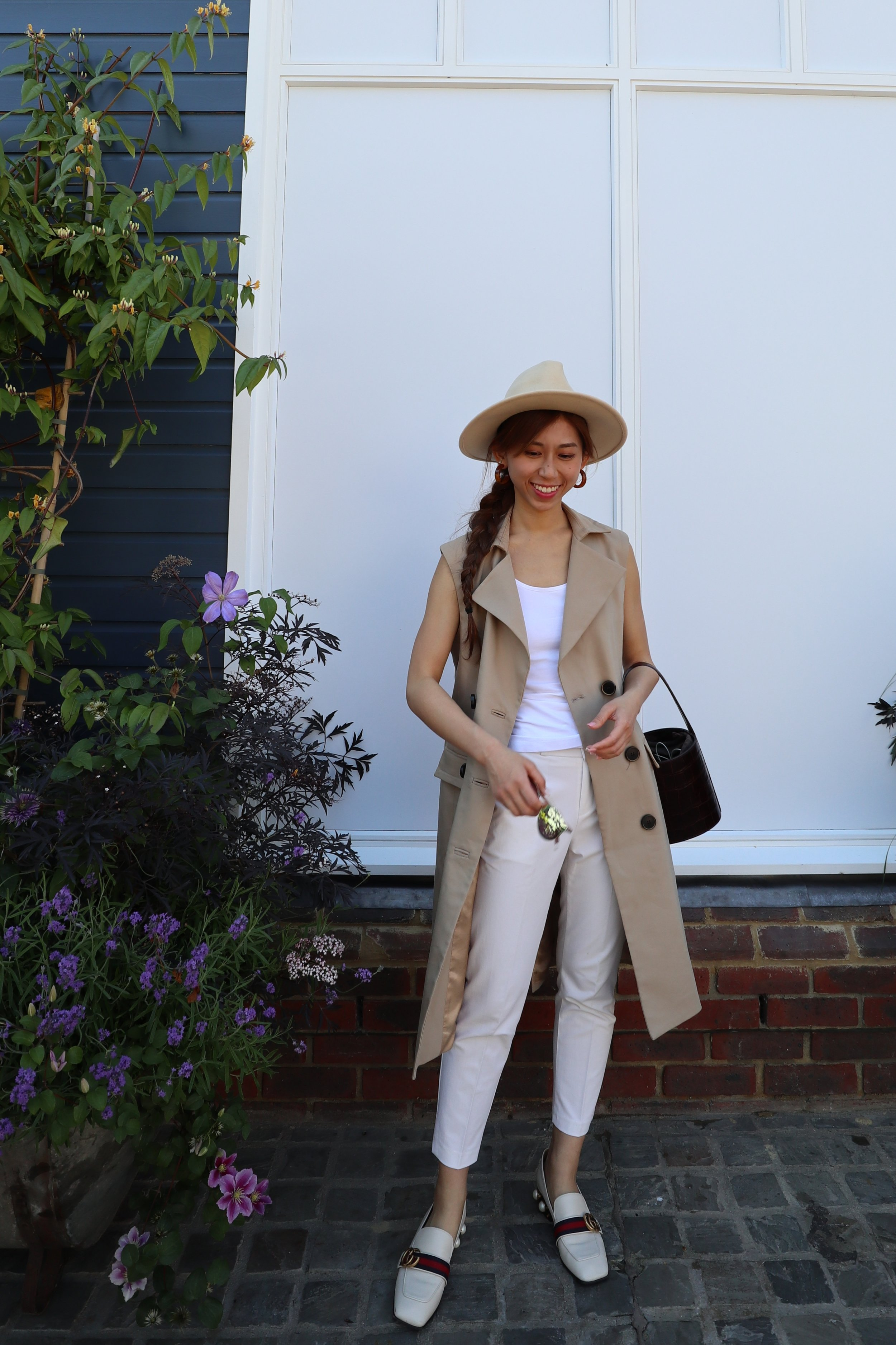 - Top: H&M white tankBottom: from KoreaJacket: ZARA double breasted waistcoat dressHat: LACKOFCOLOR ivory rancherBag: Staud mini shirley bag clear (tan faux)