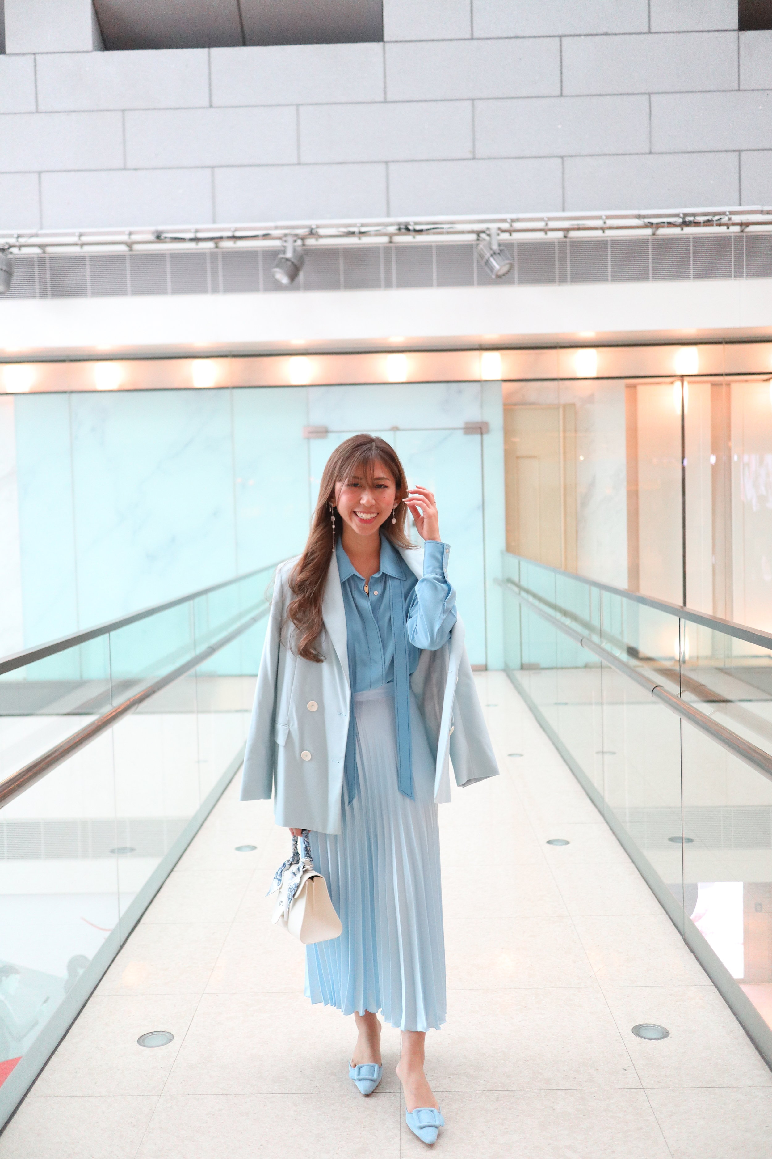 - Top: SANDRO silk shirt with pussy bow collarBottom: ZARA powder blue pleated skirtBlazer: Zara sky blue double breasted jacketBag: Delvaux ivory brillant miniShoes: MANOLO BLAHNIK maysale 50 suede