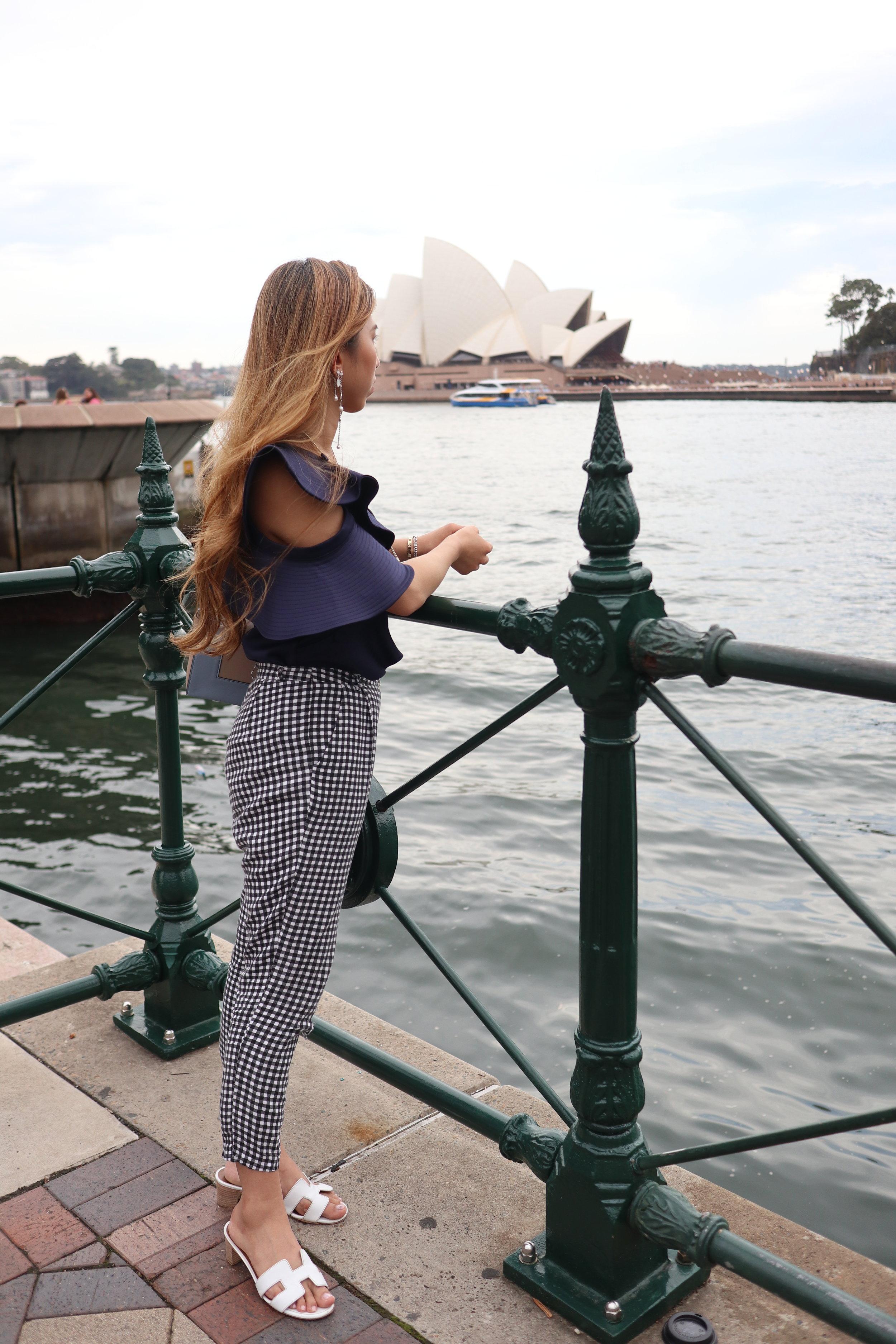 - Top: Self-Protrait one-shoulder ruffled duchess-satin topBottom: Fashmob gingham pantsShoes: Hermes Oasis sandalsBag: Celine Frame