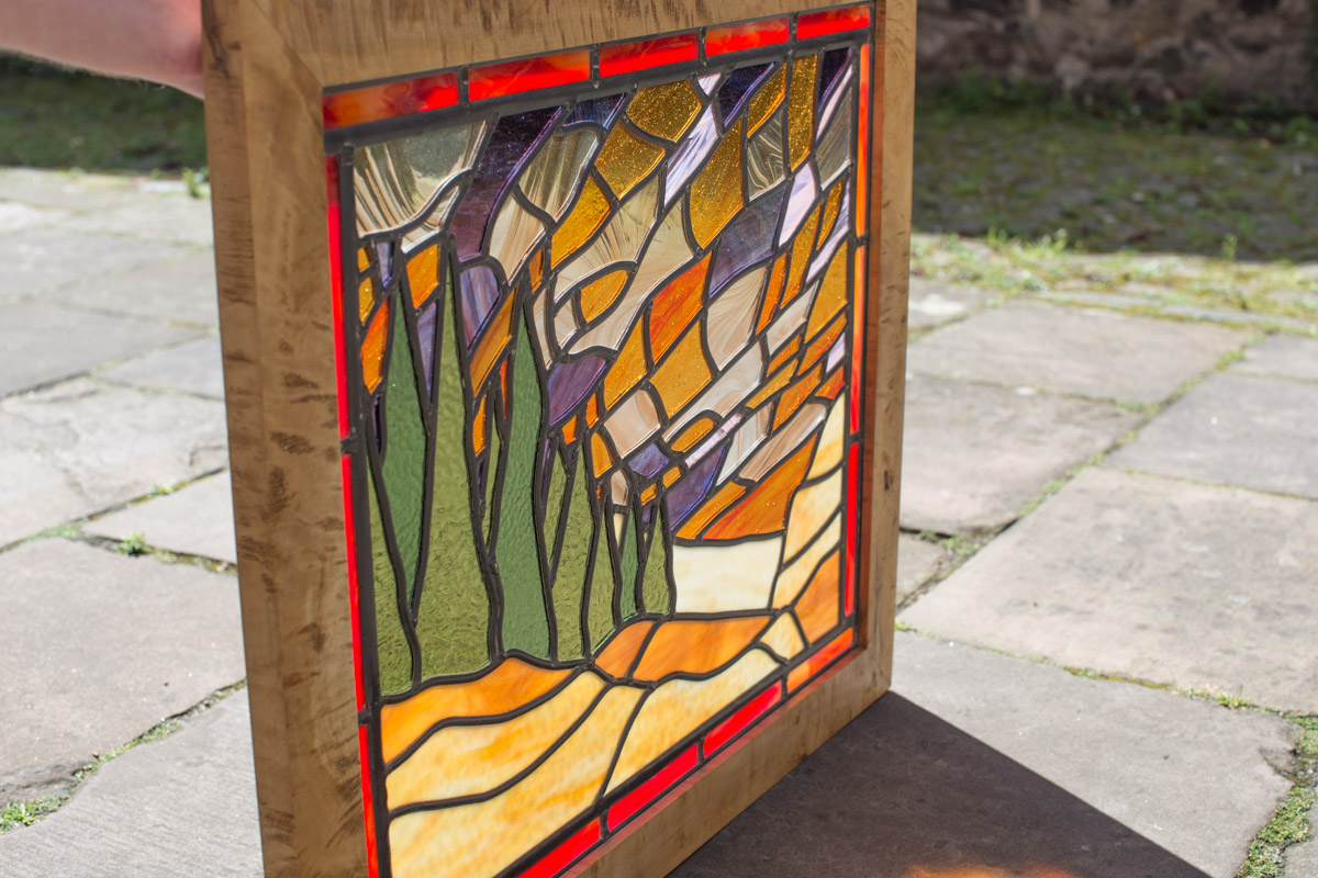 Rippled sycamore frame, glass work by P Gillies