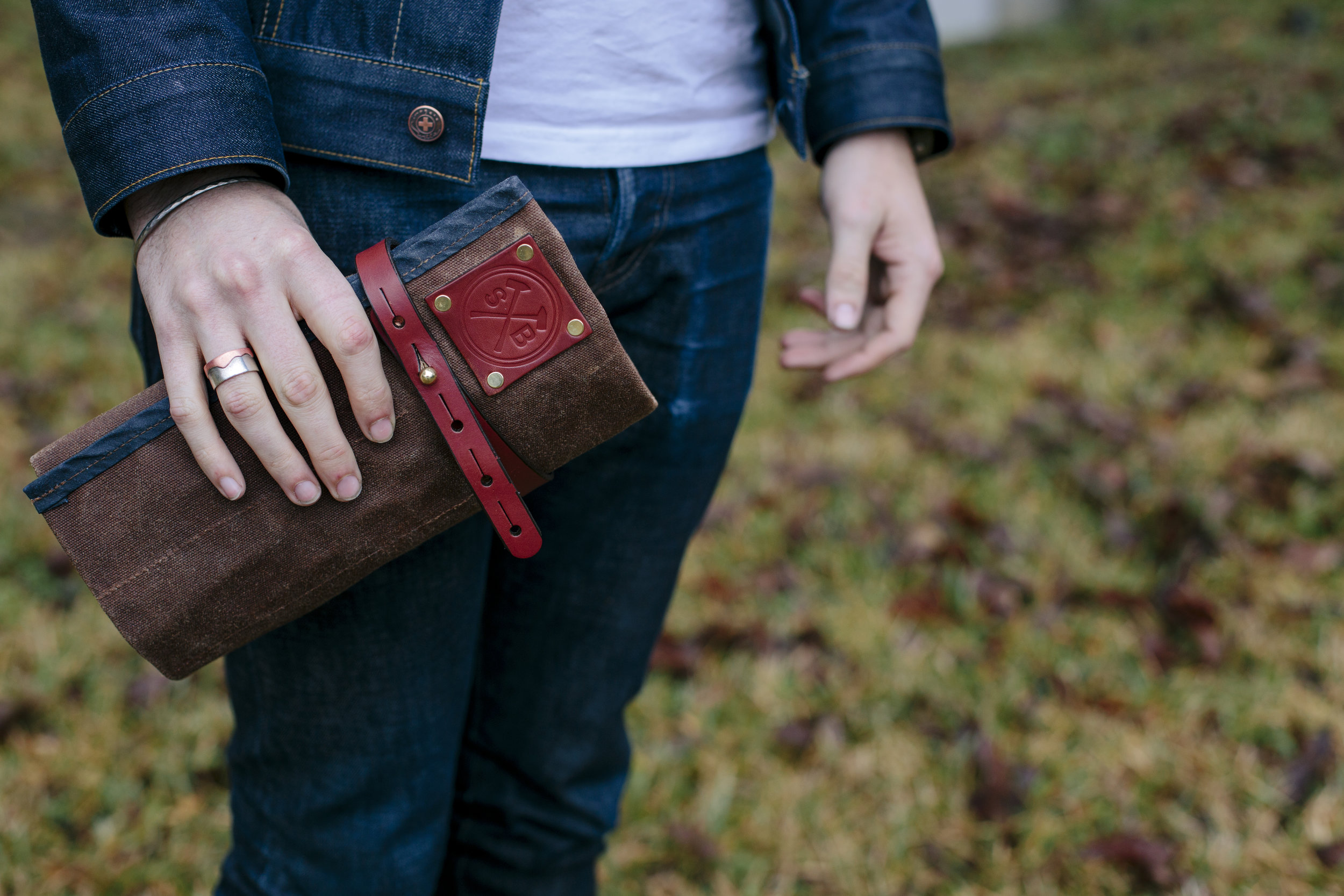 orville tool roll in hand sturdy brothers waxed canvas.jpg