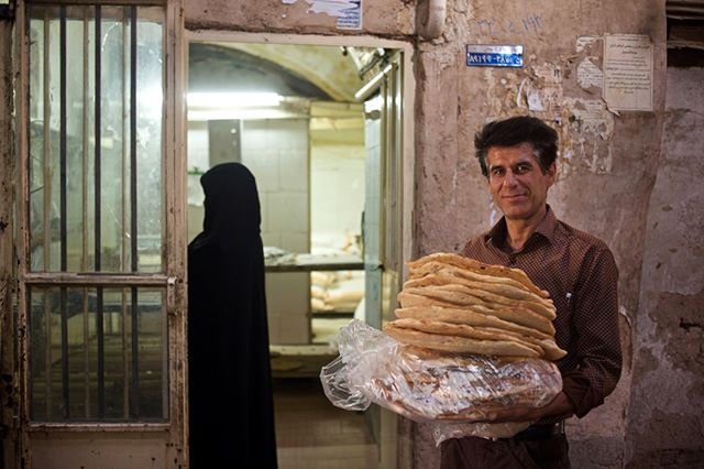 """Posting images of Iran and Iranian people to mark """"Cyrus the Great Day"""" or """"Cyrus Day"""", روز کوروش October 29 (7th of Aban آبان)  A bread seller in the old, covered market, Yazd, Iran. … On 29 October 539BCE the Persian king Cyrus II walked triumphantly into Babylon, the ancient Mesopotamian capital and seat of a huge empire that straddled the middle east.  Follow @tribaleye for updates, outtakes, unpublished and archive material  #yazd  #portrait  #iran  #market #globalnomads  #wanderlust  #traveltheworld  #travelgram  #travelphoto  #travelawesome #documentaryphotography #bread #iranian #Persian  #documentary #igtravel #visualarchitects @dpinteractive"""
