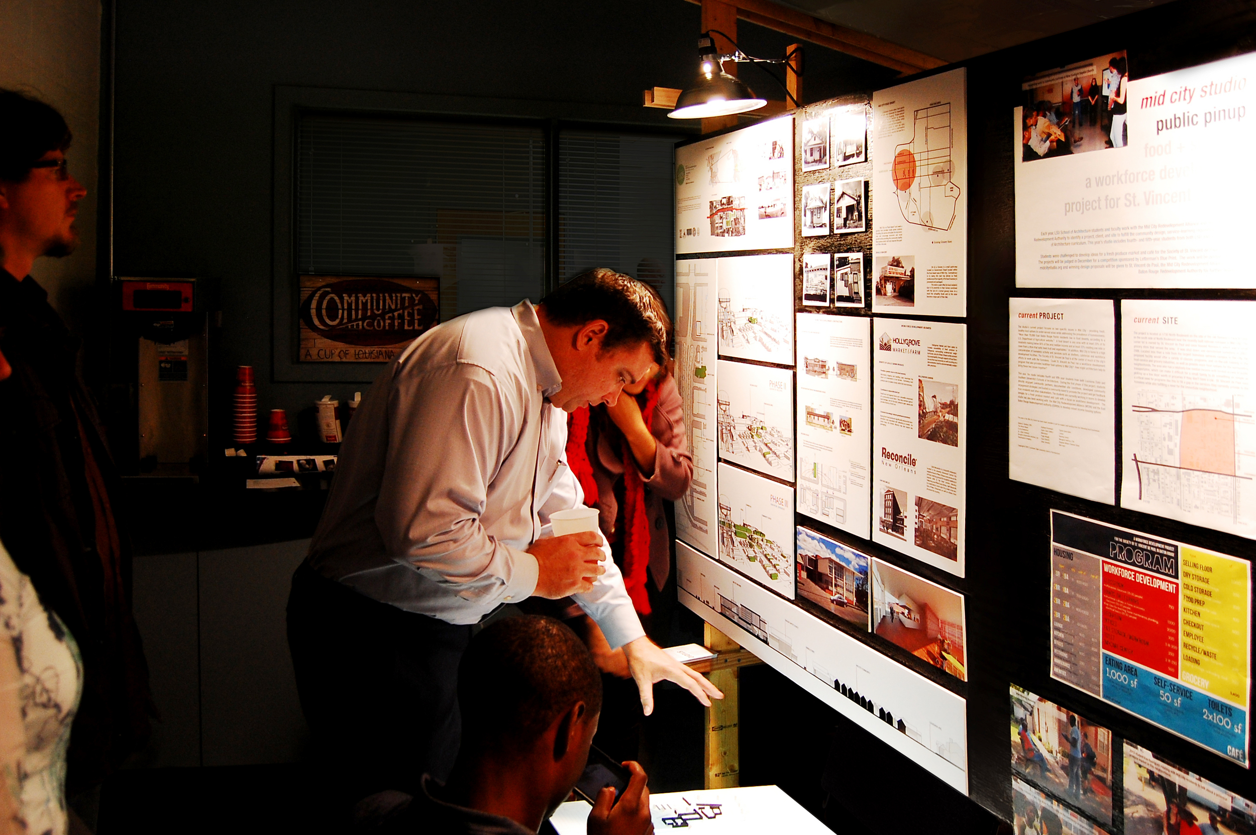 008_Letterman's owner Steve Perret talks to students about their projects at White Light Night.jpg