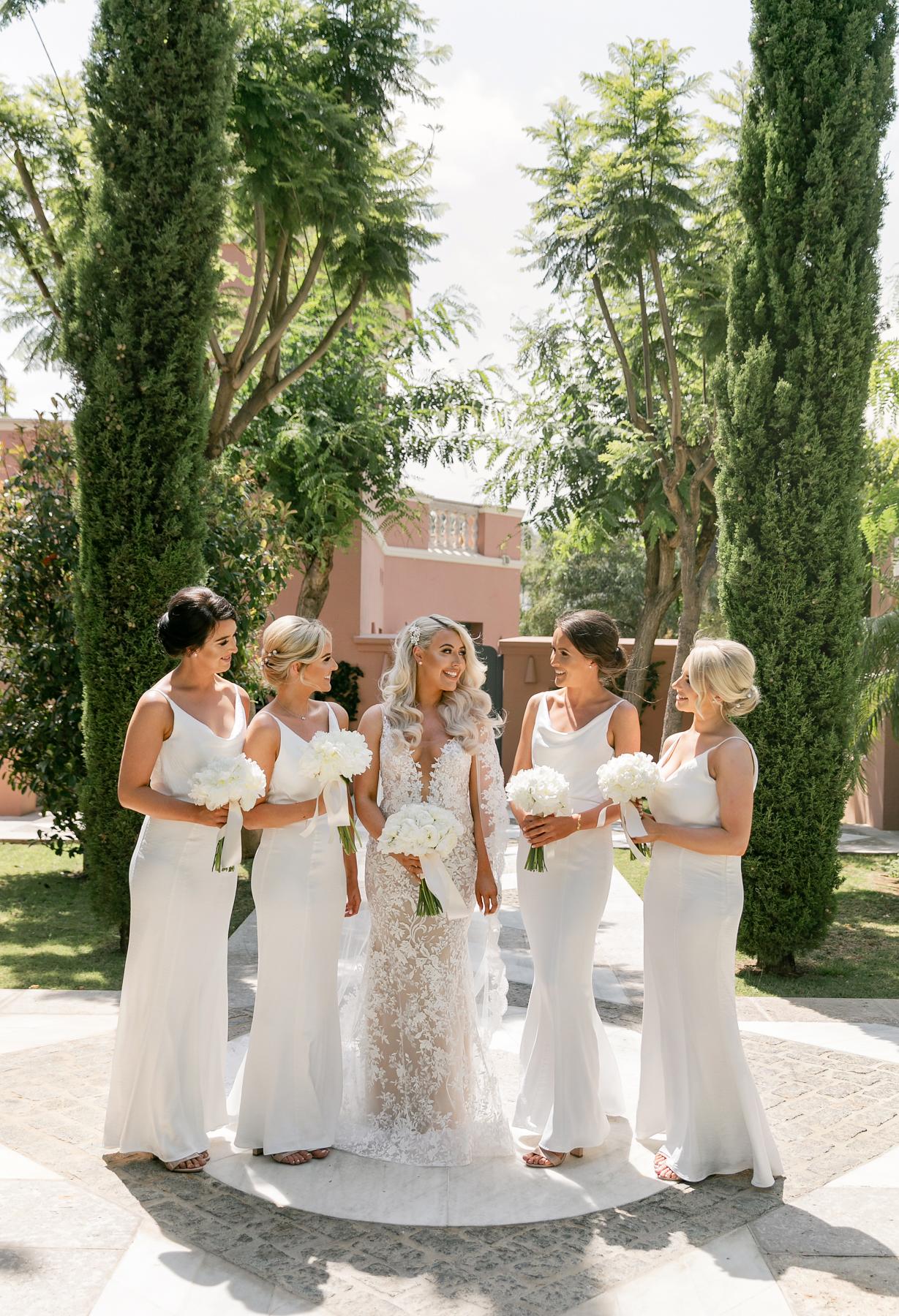 Bridesmaids in white luxury beach destination wedding