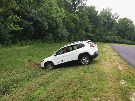 """A Jeep Cherokee winds up in a ditch after hackers working with """"Wired"""" magazine successfully take control of the vehicle by hacking in through its connected-car infotainment system. (Photo: Wired Magazine)"""