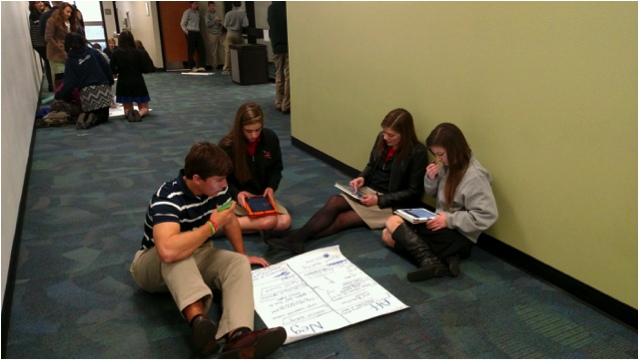 Florence Academy students prepare points on a practice debate resolution