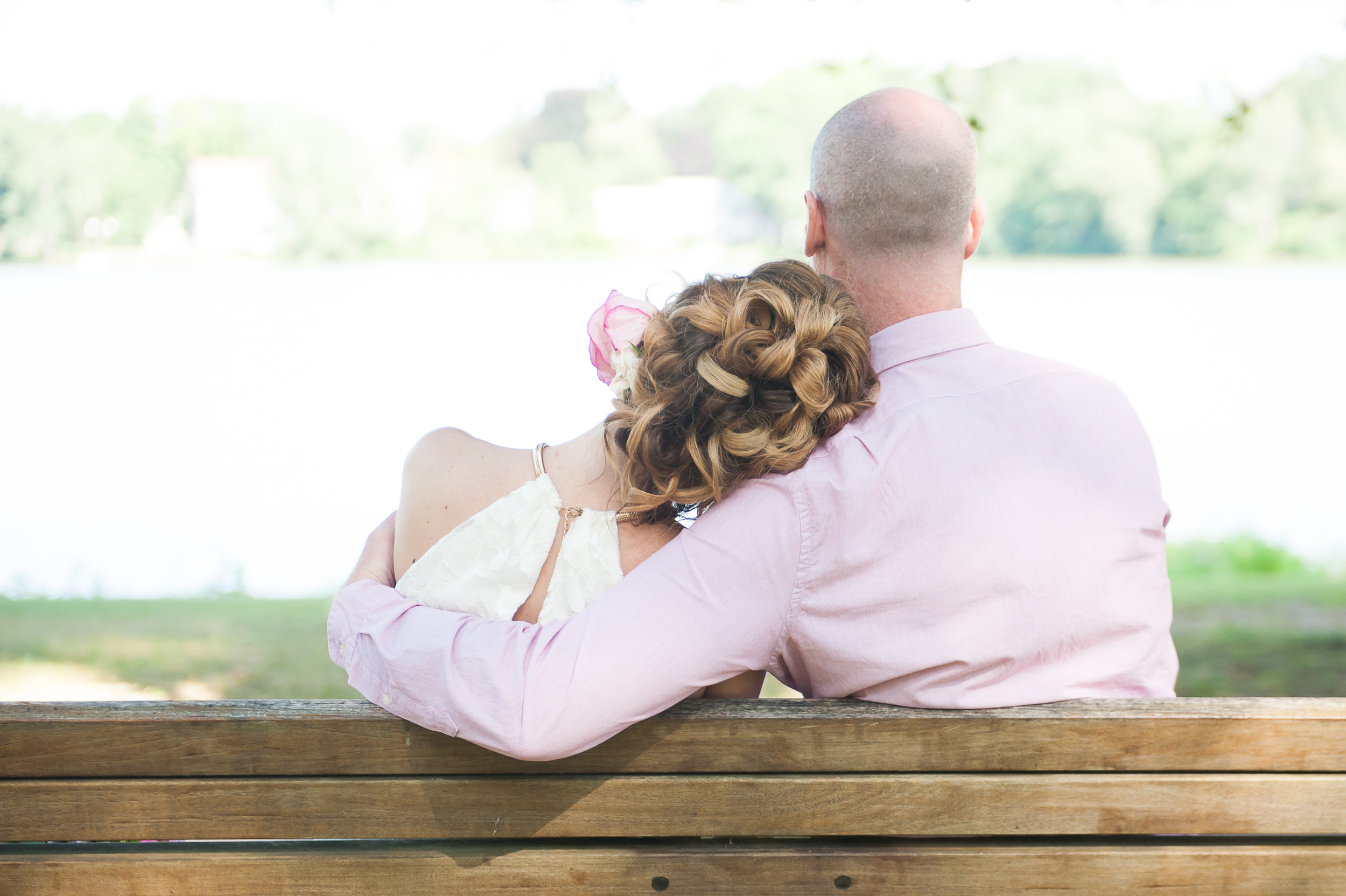 Bride and Groom wedding formals on a park bench Lake Quannapowitt wedding photographer MA
