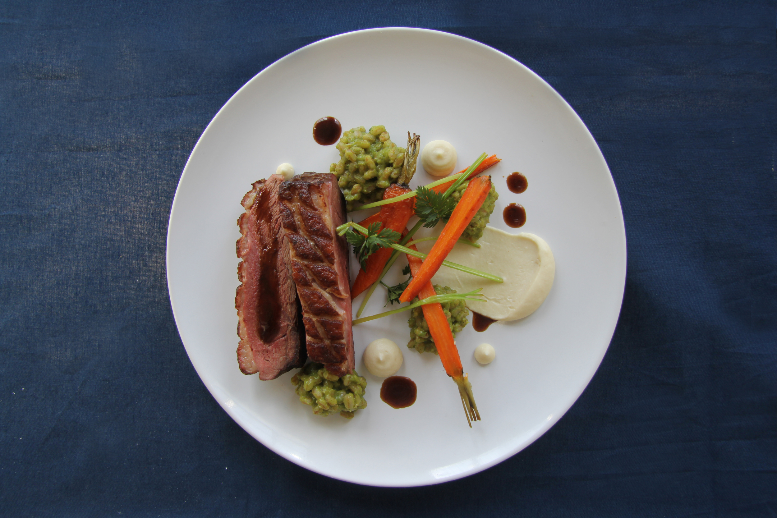 Roasted Duck Breast. Herb Farro Risotto. Celery Root Purée. 2 hour Roasted Carrots in duck fat. Black Garlic Sauce.