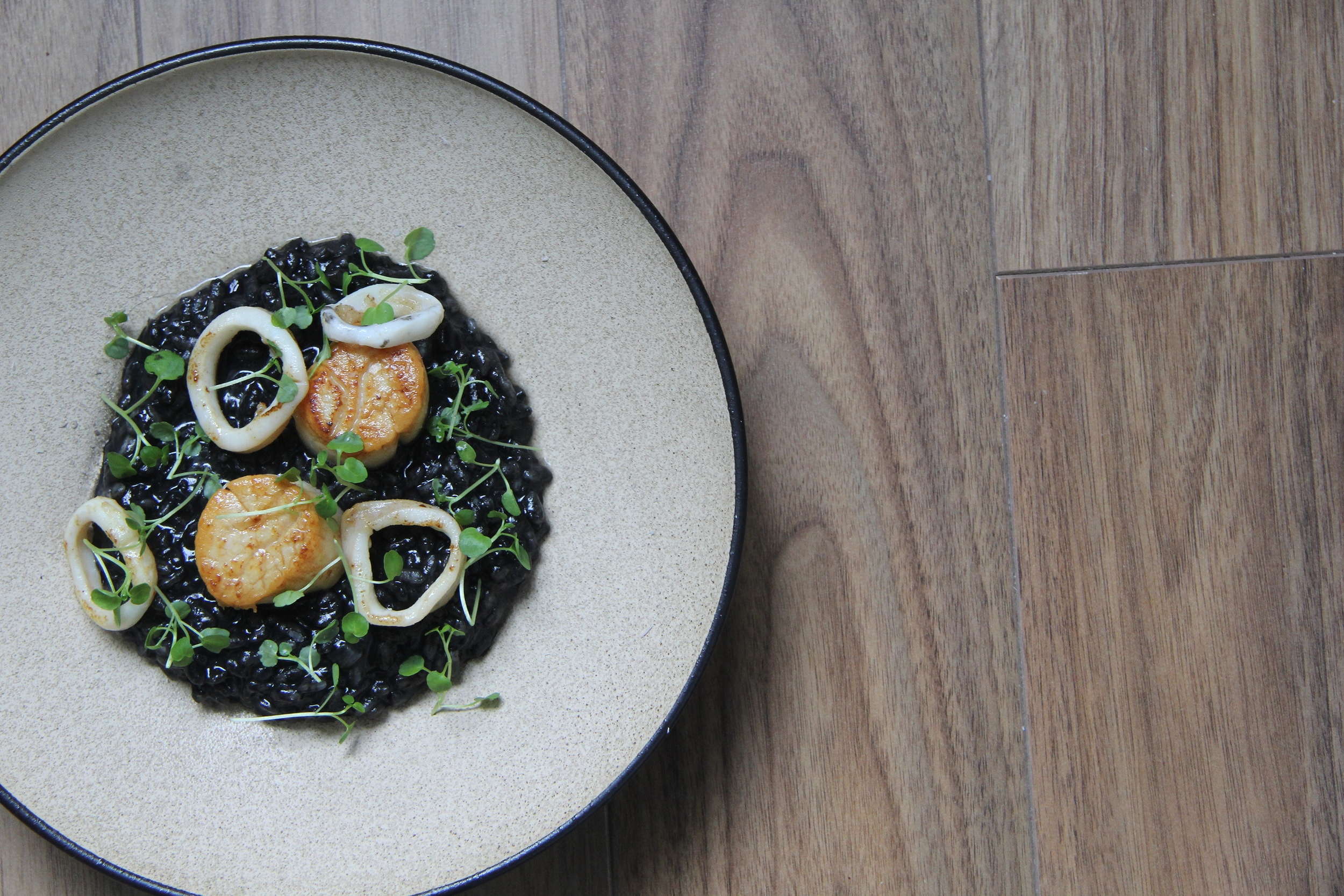 Squid ink Risotto. Seared Scallop and squid.
