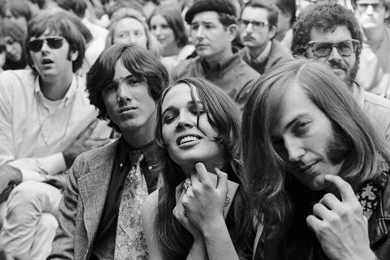 A young woman's joy in the music transcends the emotions of those around her, including her friend Sam Andrew (right) of Big Brother and the Holding Company.