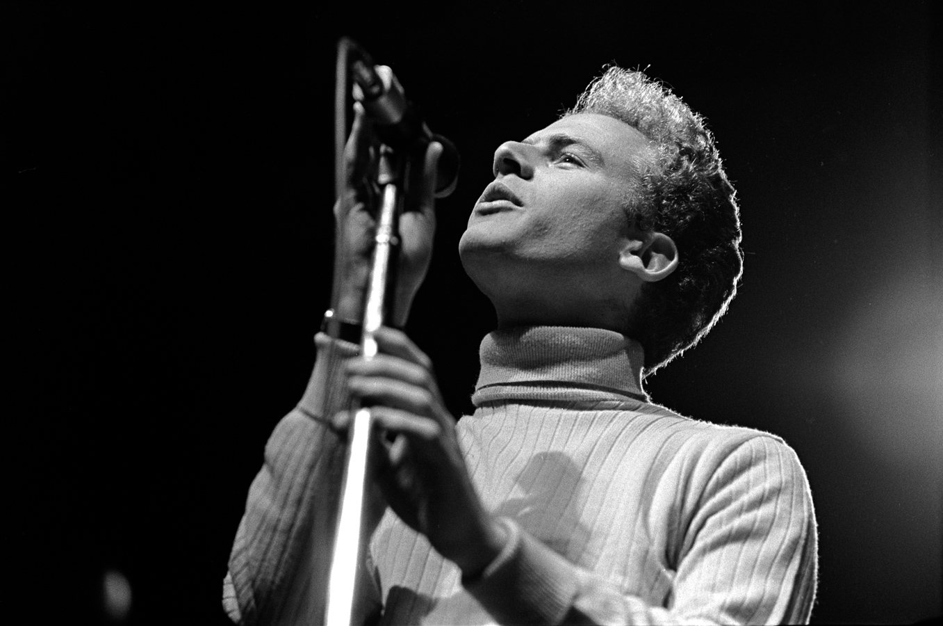 Art Garfunkel brought a sweet, upper range to Paul Simon's lower range voice. They represented the East Coast sound well.