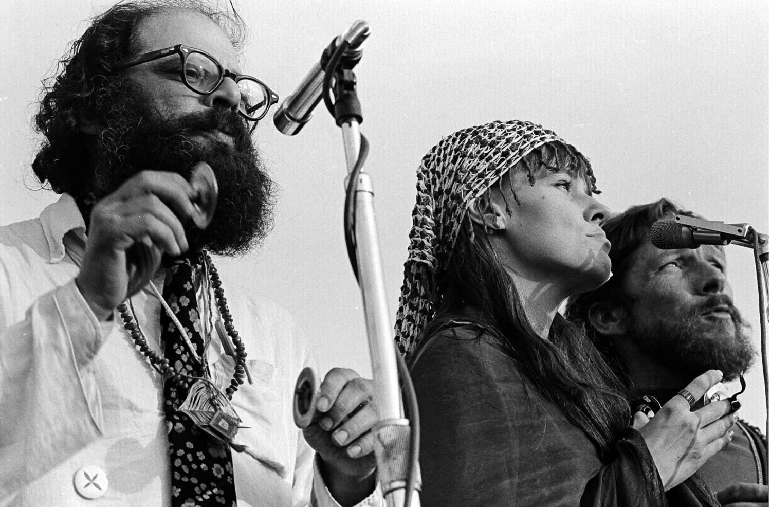 Allen Ginsberg  (left),  Maretta Greer (center) and  Gary Snyder  (right) read poetry and chant a mantra to peace at the Human Be-In.