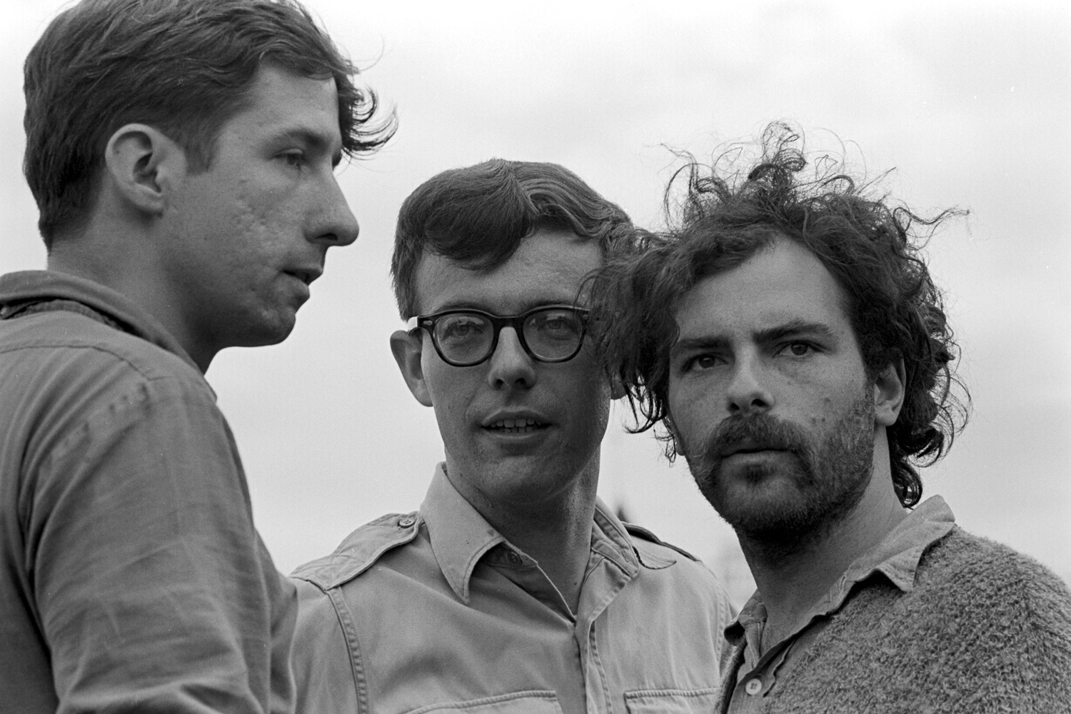 Tom Hayden (left), Rennie Davis (center) and Jerry Rubin (right) put their heads together in the open air at Lincoln Park.