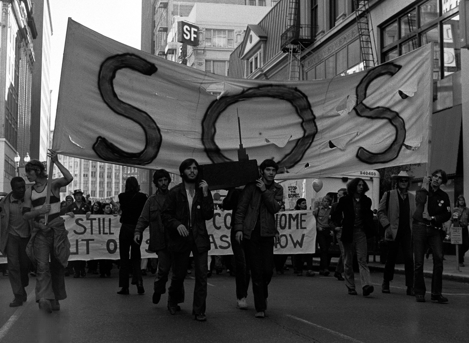 Some of the leaders of the Stop Our Ship movement are marching down Market Street, at the front of a peace march on Nov. 6, 1971. They are carrying a wooden model of the aircraft carrier USS Coral Sea on their shoulders like a coffin.