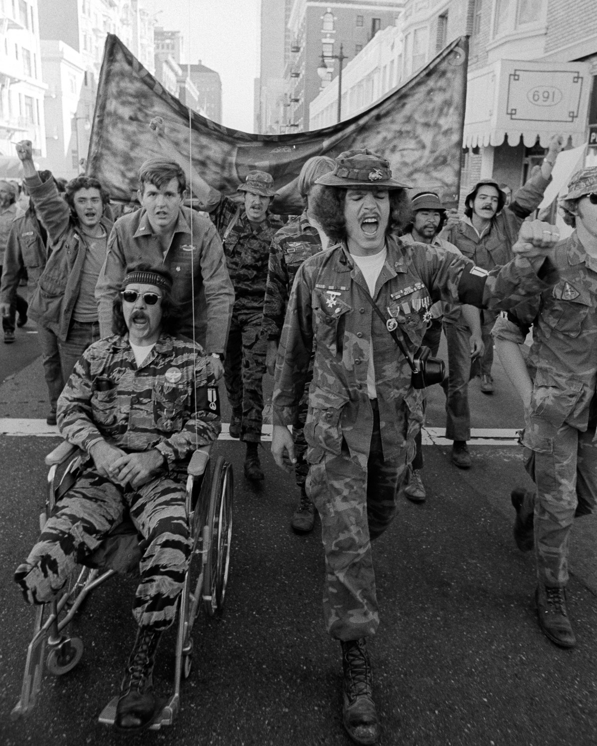 A contingent of veterans joins the march in support of the USS Coral Sea sailors movement to stop their ship from sailing to Vietnam.