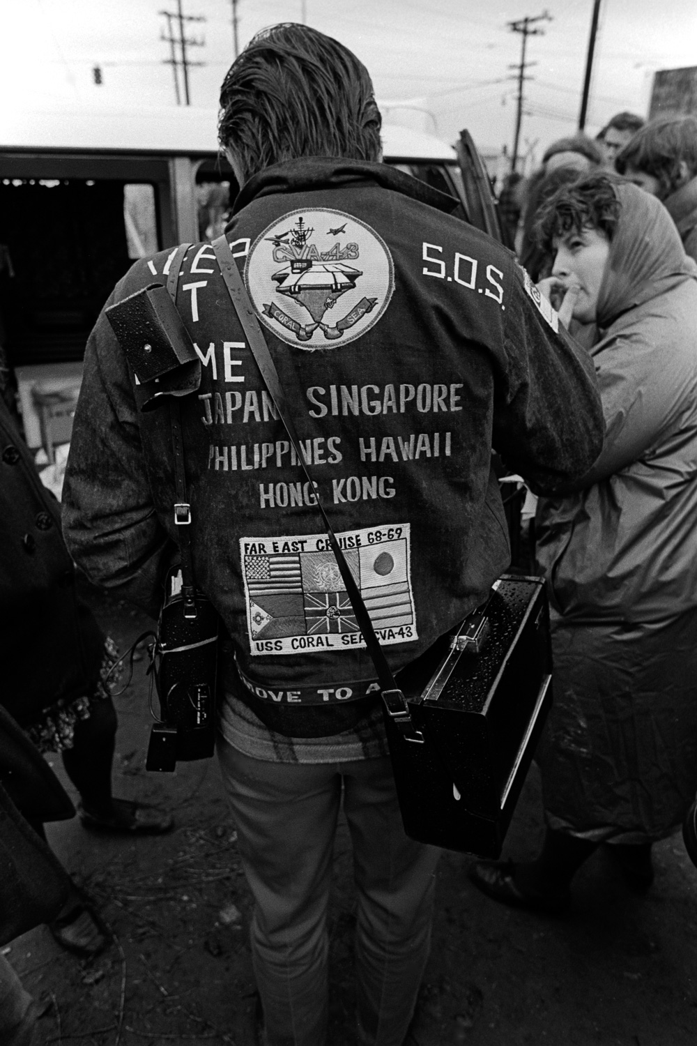 """This sailor's jacket reflects the ports-of-call where his ship, the USS Coral Sea, has called. At the top of his jacket, he added: """"Keep it home. SOS."""""""