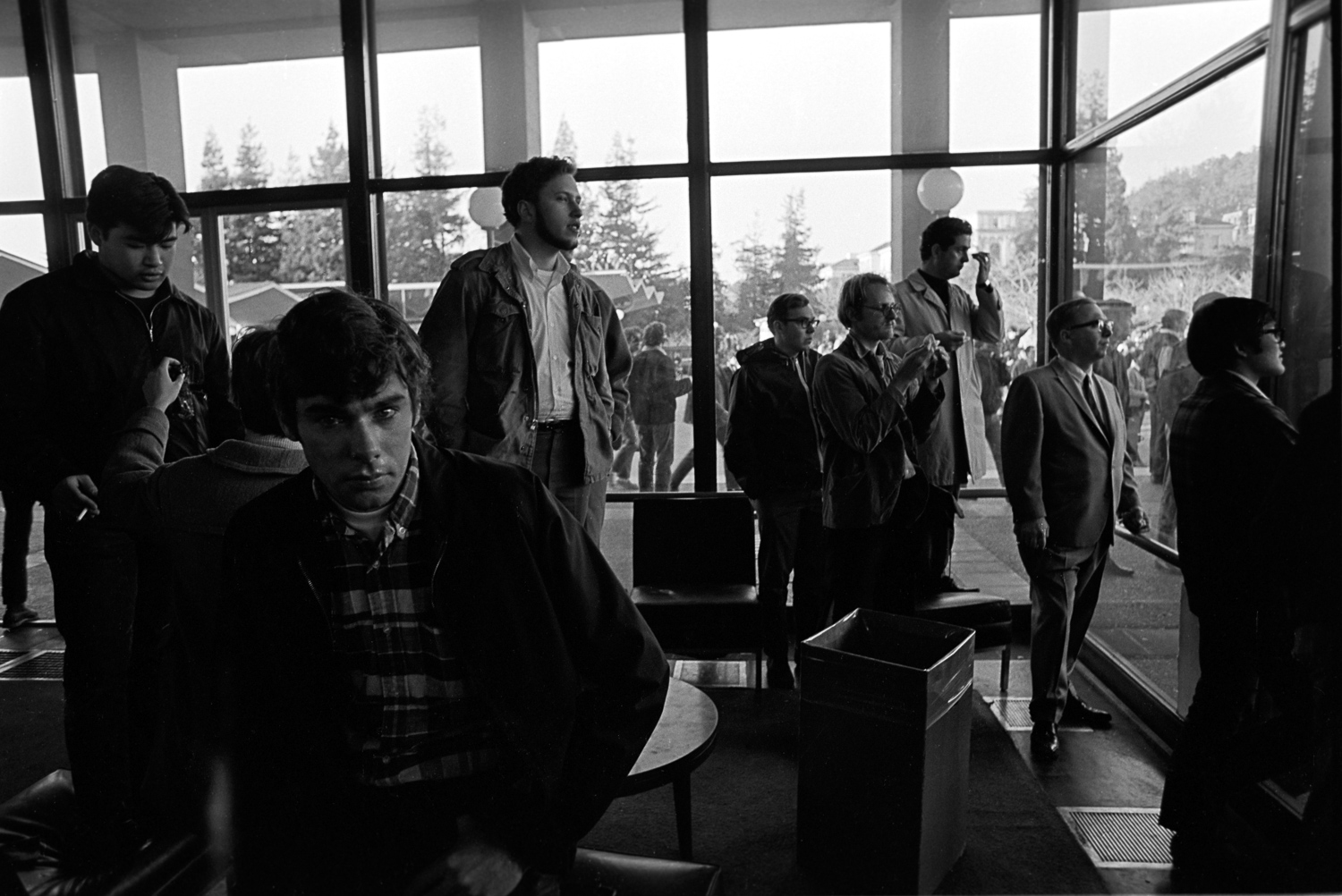Some Berkeley students preferred the view from inside the glassed buildings where the campus bordered Telegraph Avenue.