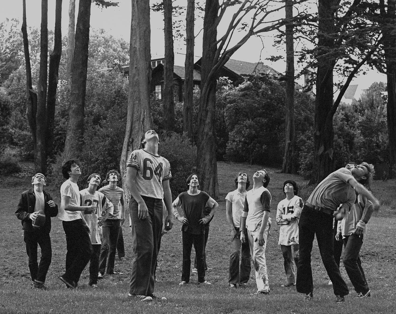 Boys throwing a football as high as they can, in a park on Lake Street in San Francisco's Richmond district.