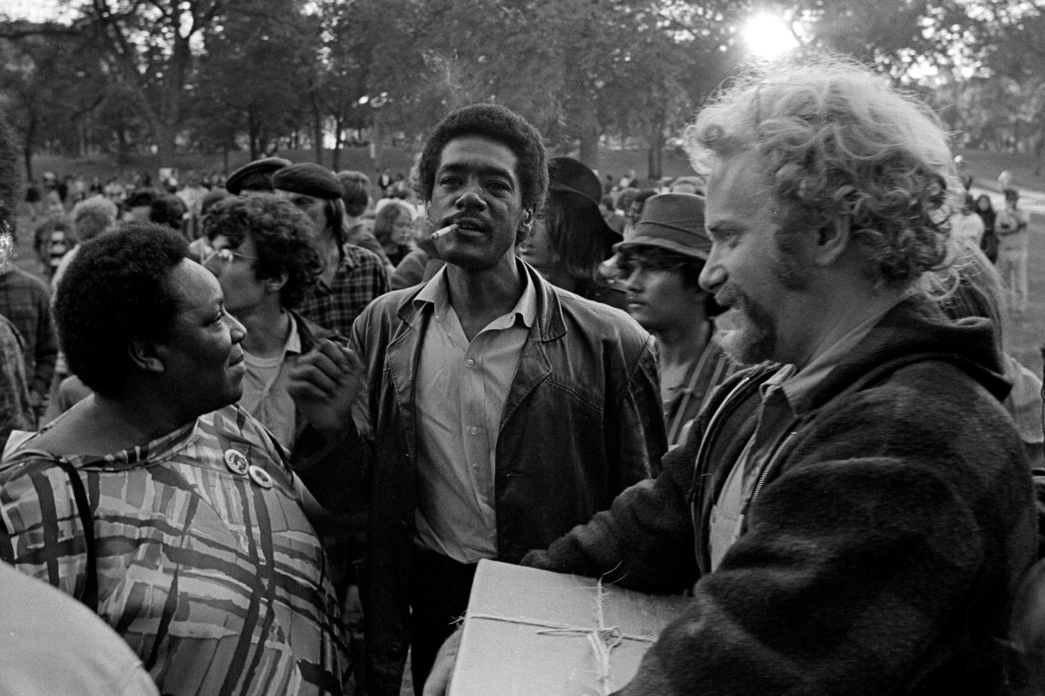 Bobby Seale (center) and Stew Albert (right) and an unidentified leader of the civil rights movement (left) at Lincoln Park in Chicago during the Democratic Convention, August 1968