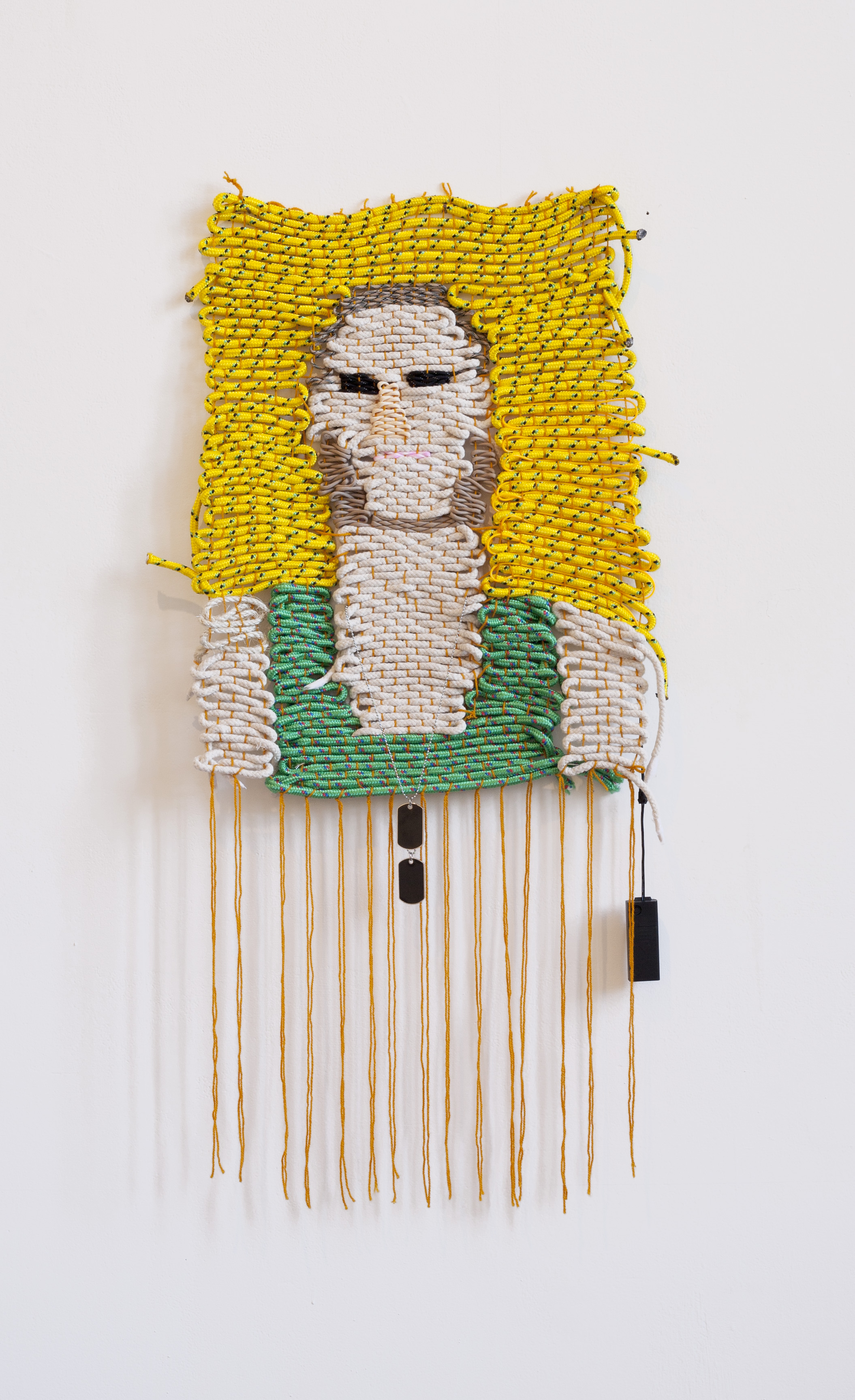 any near ur pussy ?,2015 Wool, polypropene rope, paracord, cotton sash cord, electroluminescent wire and dog tags. 130 x 50cm  Photo by Nathan Brooker.