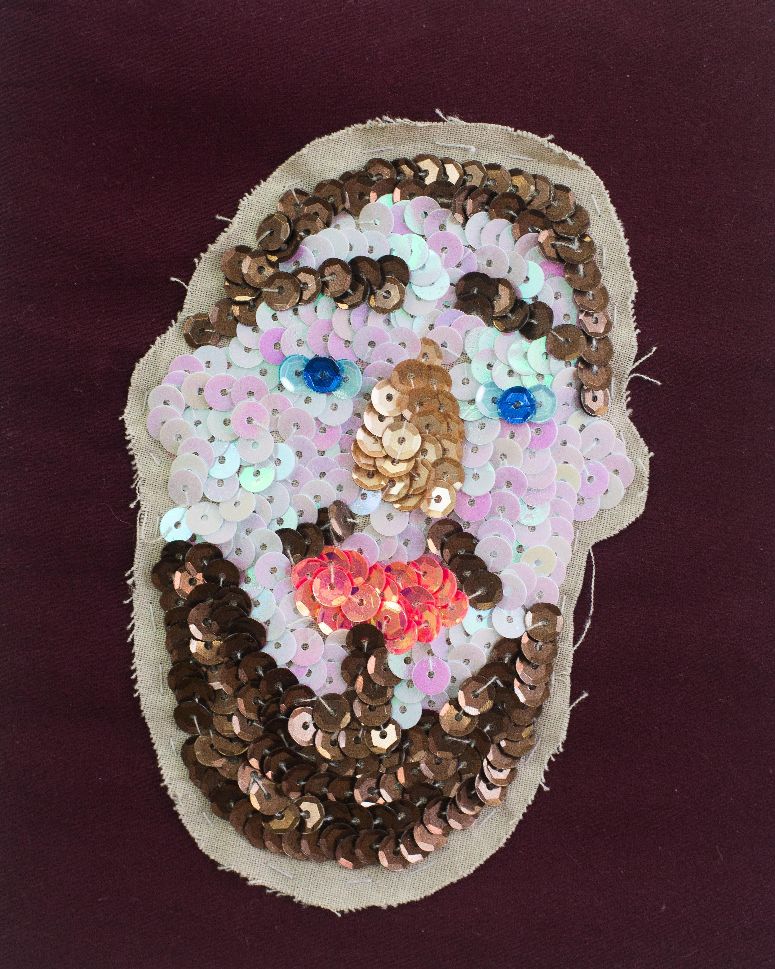 Duncan (A talisman for successful tindering) (Detail) Cotton, sequins, paper mache, dowel, glitter