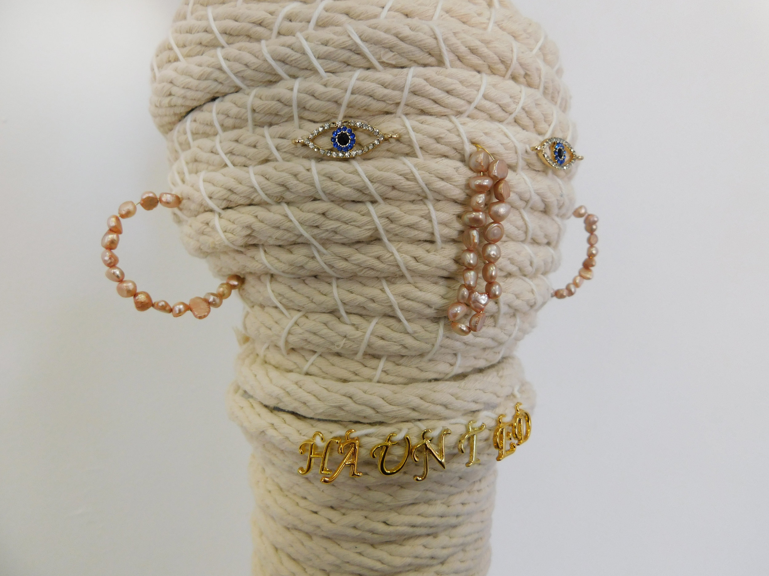 Apparition (Jesse) , (Detail). 2019 Cotton sash cord, metal charms, fresh water pearls, glass