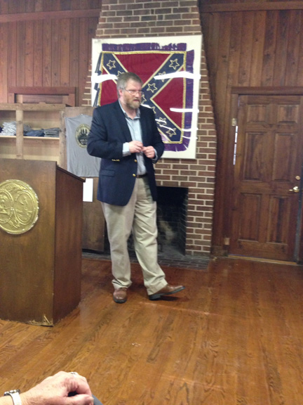 Dr. Eric Plaag speaking in February 2015 in front of a Confederate battle flag-- IN A MUSEUM, WHERE IT BELONGS.  Photo courtesy of Gloria Tuten.