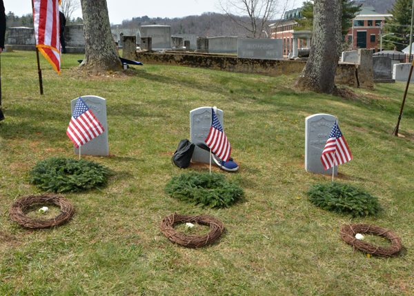 Wreaths and flags adorn the graves of (L to R) Pvt. John E. Maricle, Pvt. Henry P. Evans, and Pvt. William T. Bradley in the Boone Cemetery. Photo courtesy of Ken Ketchie,  High Country Press .