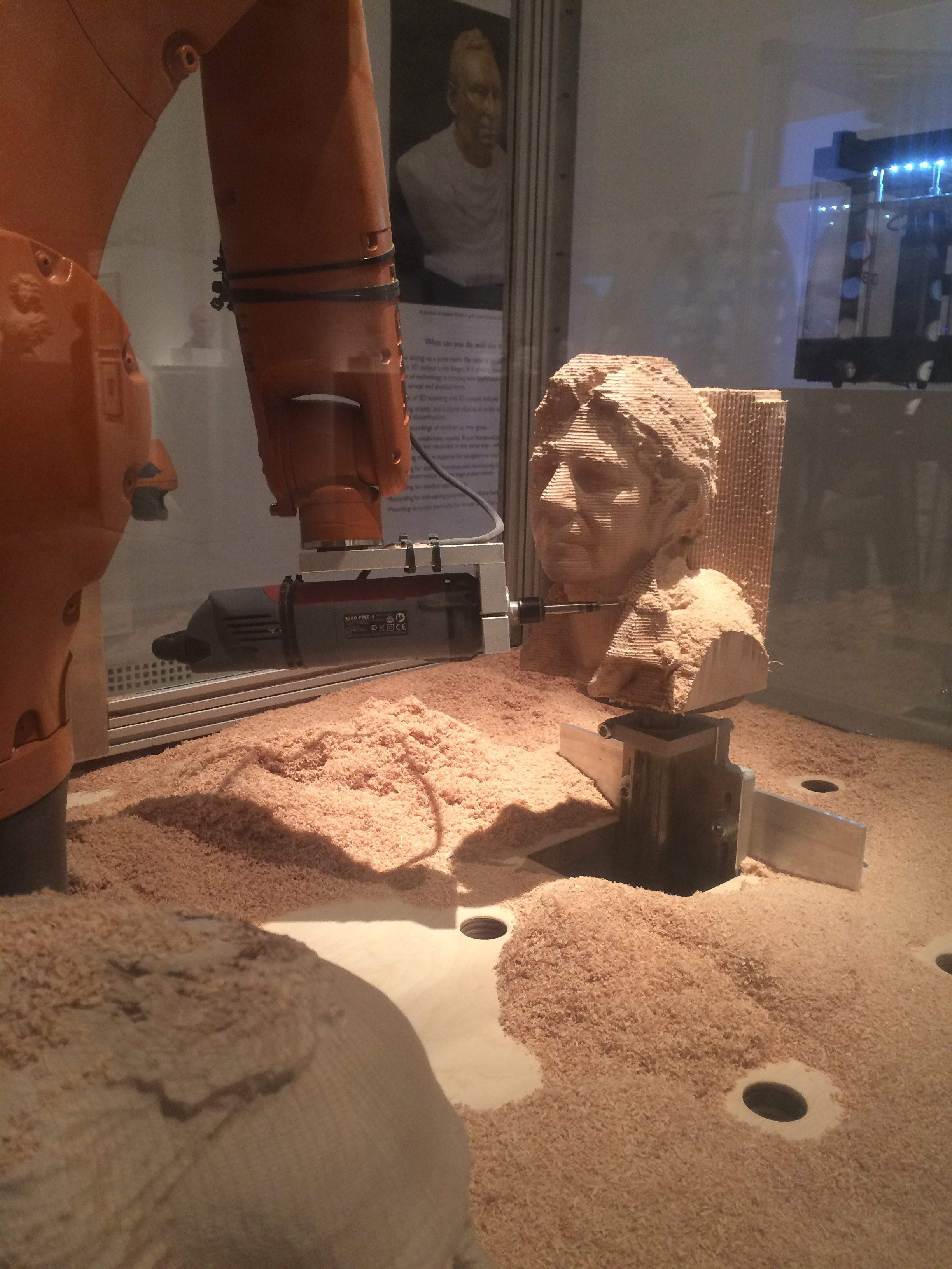 this is a robot that made sculptures it is awesome. the robot looks at your face and it copy's your face on to the wood. So it was really cool.