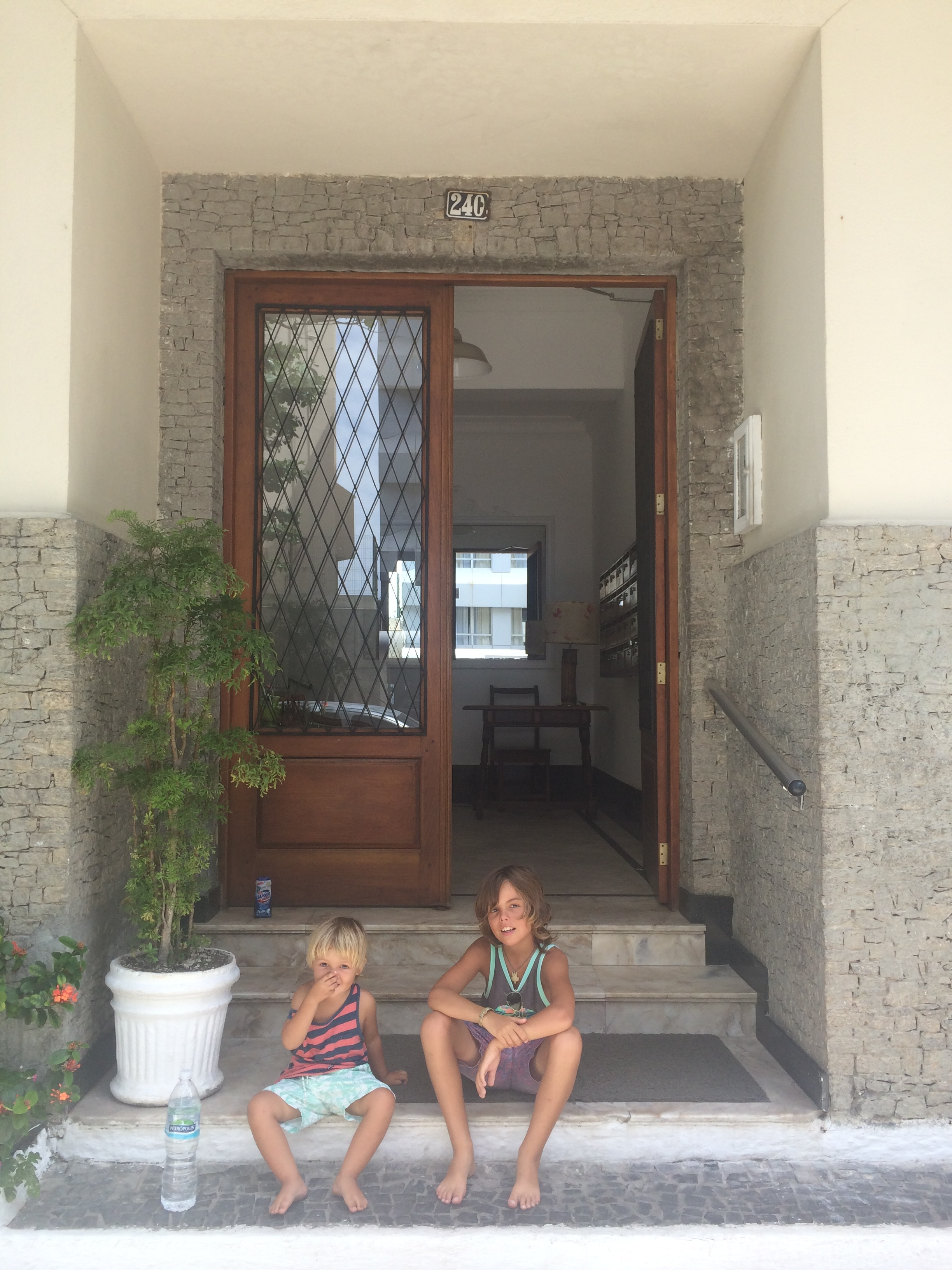 this is the front of the apartment where we live in rio i like it our beds are really confutable to sleep in and i have my own tv so i am relaxed.