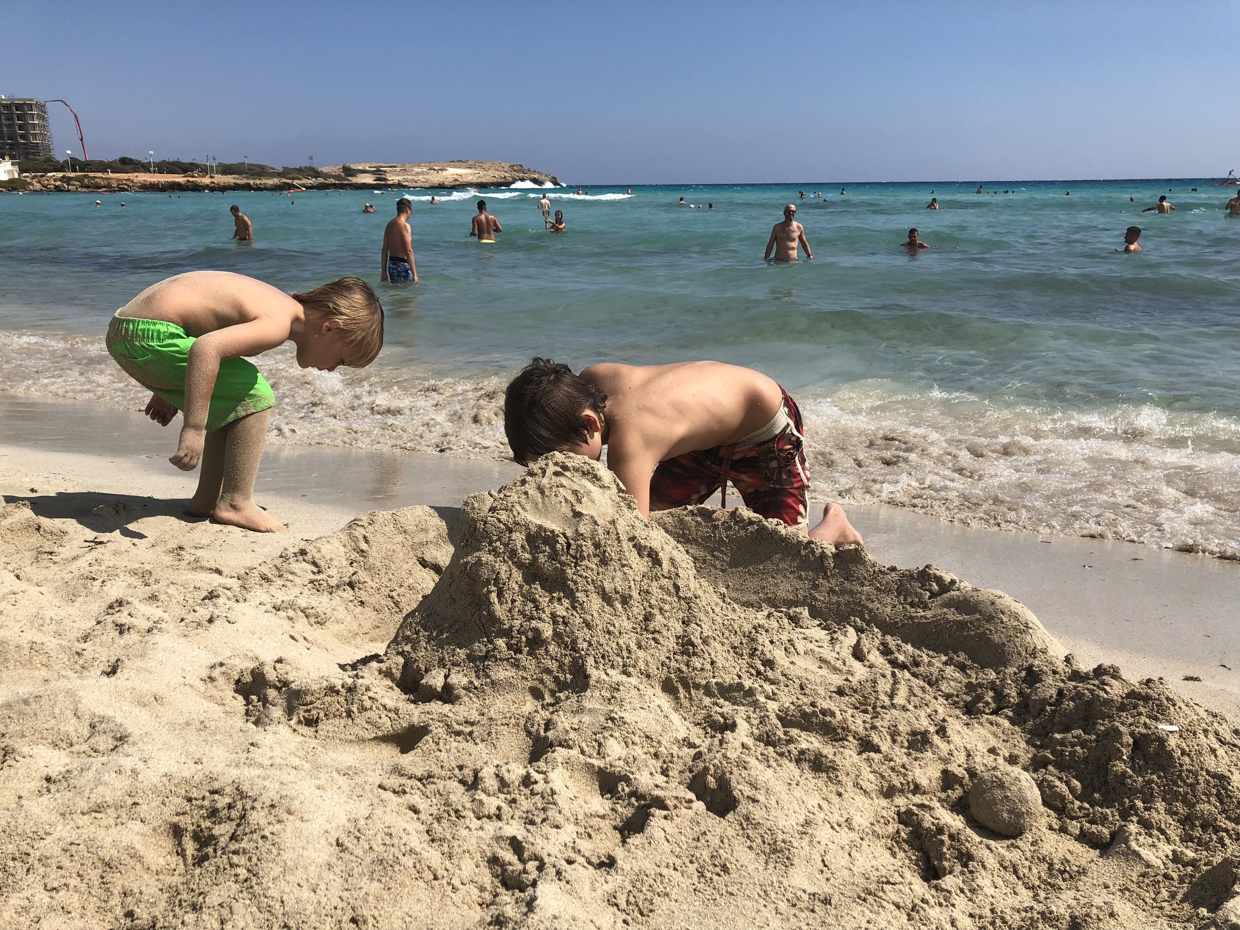We arrived at north of Larnaca which had a beautiful beach and we made a huge sand castle, it looked amazing . We made a mouth and I could put my head inside which was really cool.