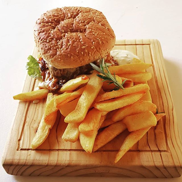 Nothing like a burger with blue-cheese sauce and chips. . . . #cafepave #cafe #burger #fries #lunch #stellenbosch #food