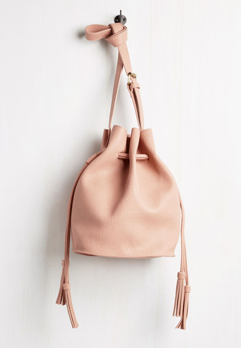 Modcloth Worth the Tassel Bag $59.99   Color:  Blush Pink  Tone:  Warm