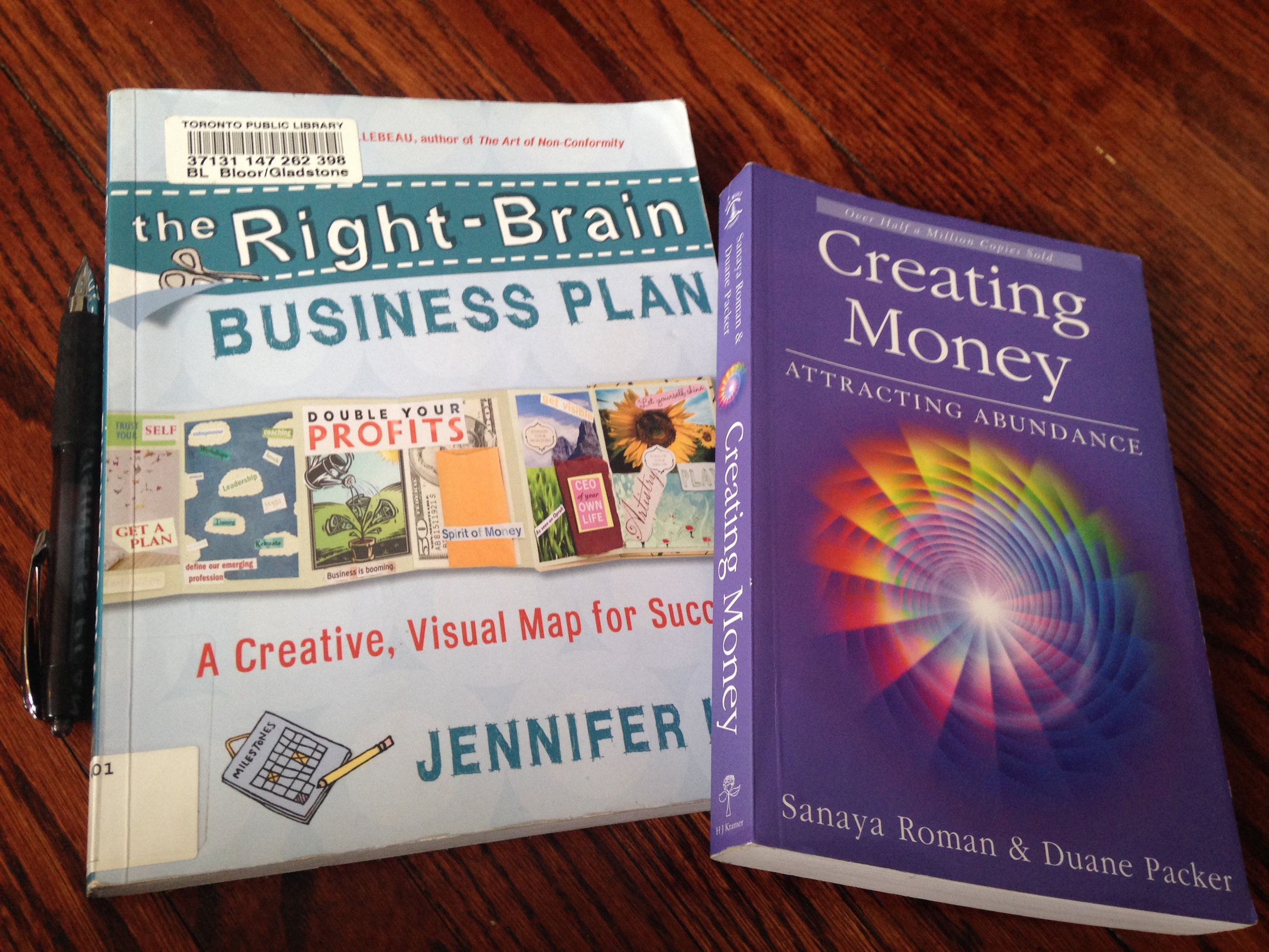 "These two books are my business bibles: ""Right Brain Business"" by Jennifer Lee and ""Creating Money: Attracting Abundance"" by Sanaya Roman & Duane Packer"