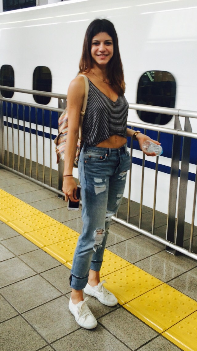 Mayara in ripped jeans and loose top.