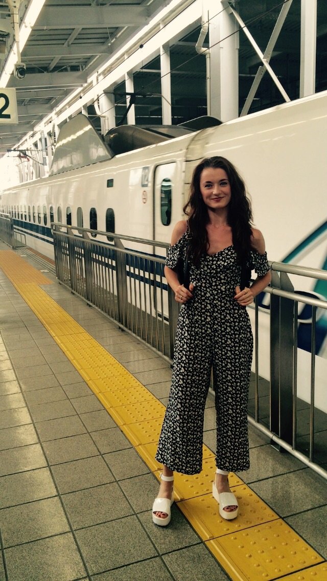 Anna wearing a loose jumpsuit.