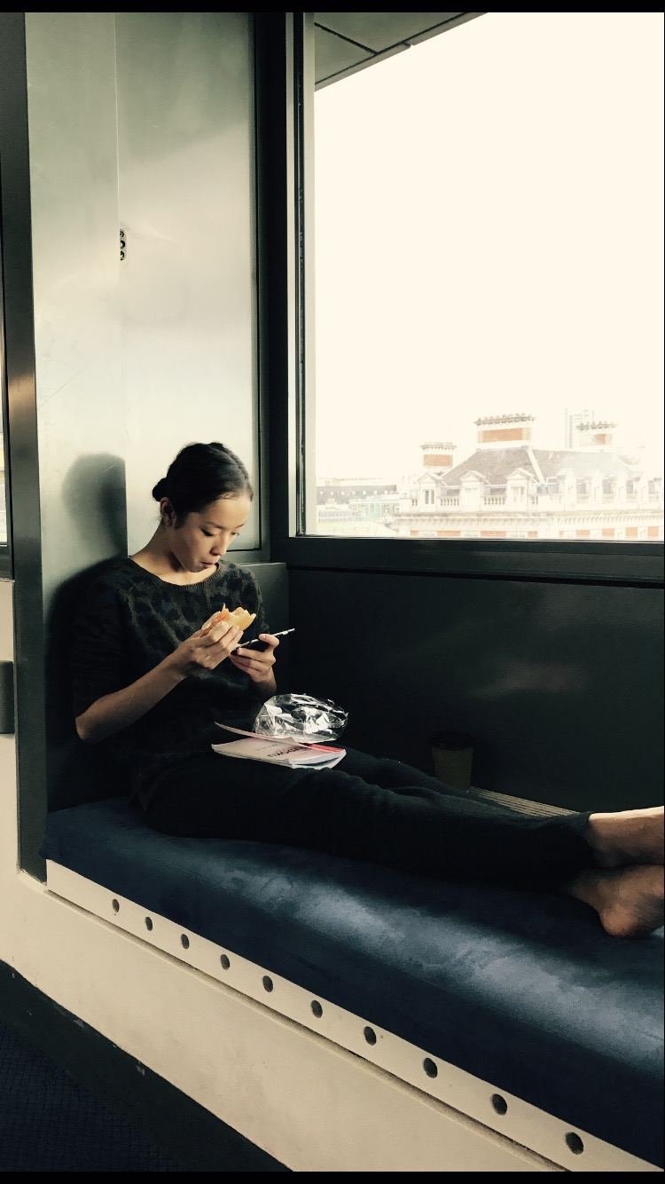 Chi in a booth in the ballet rest area