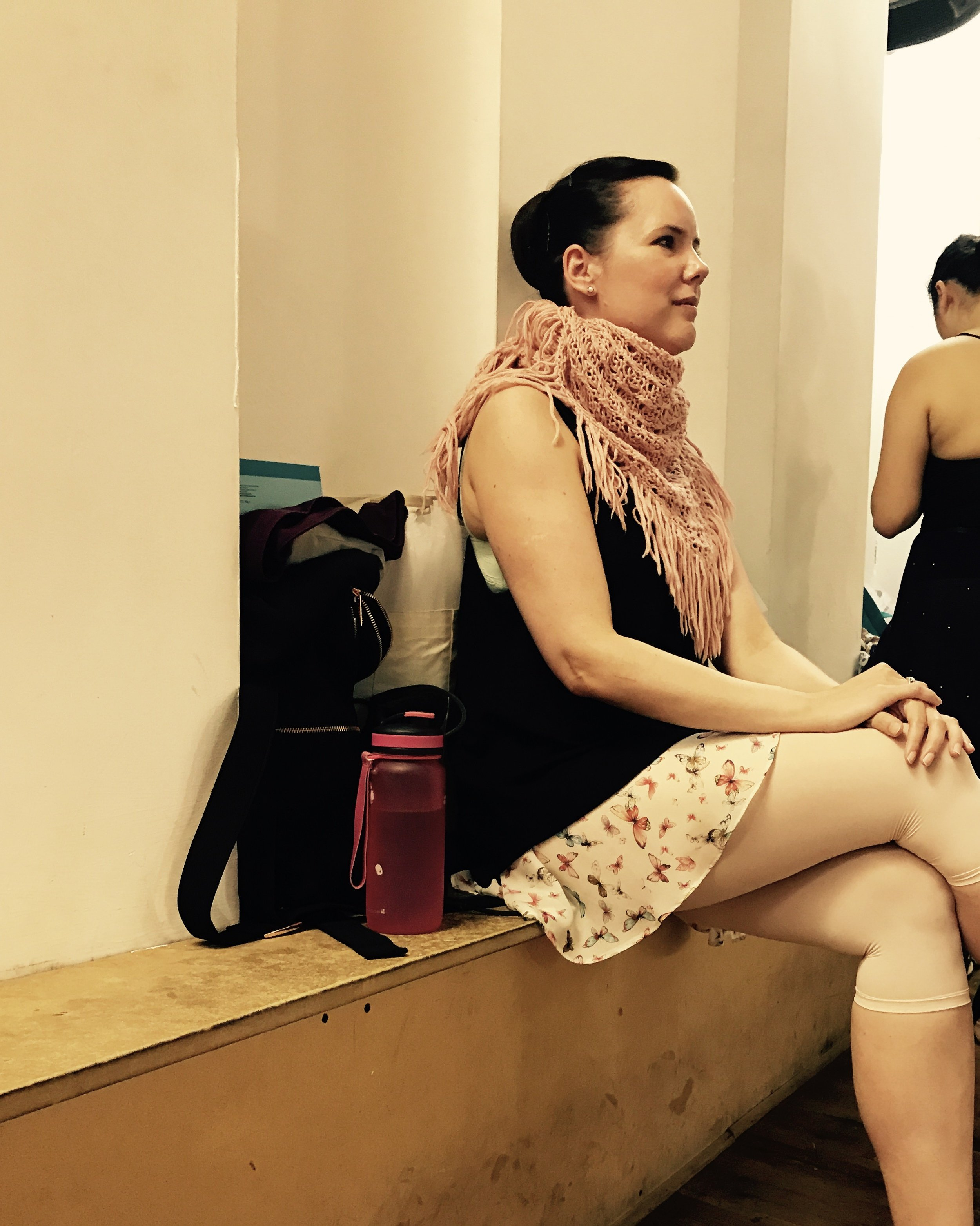 Sabina in a thick knitted scarf with a floaty floral skirt.